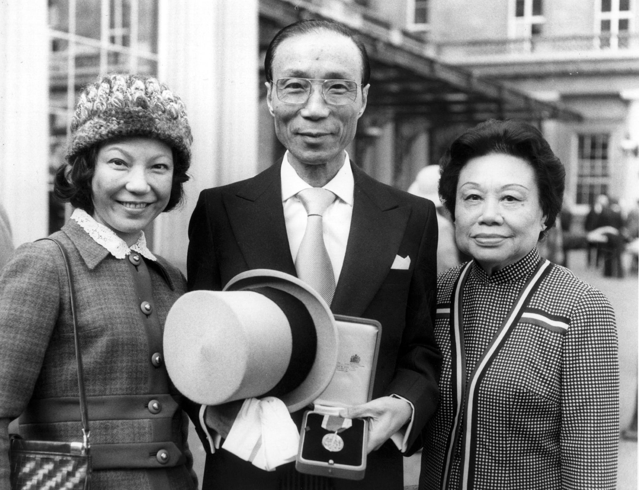 The King of Kung-Fu film makers, Sir Run Run Shaw, in London with his wife and daughter, after receiving a Knighthood from the Queen.