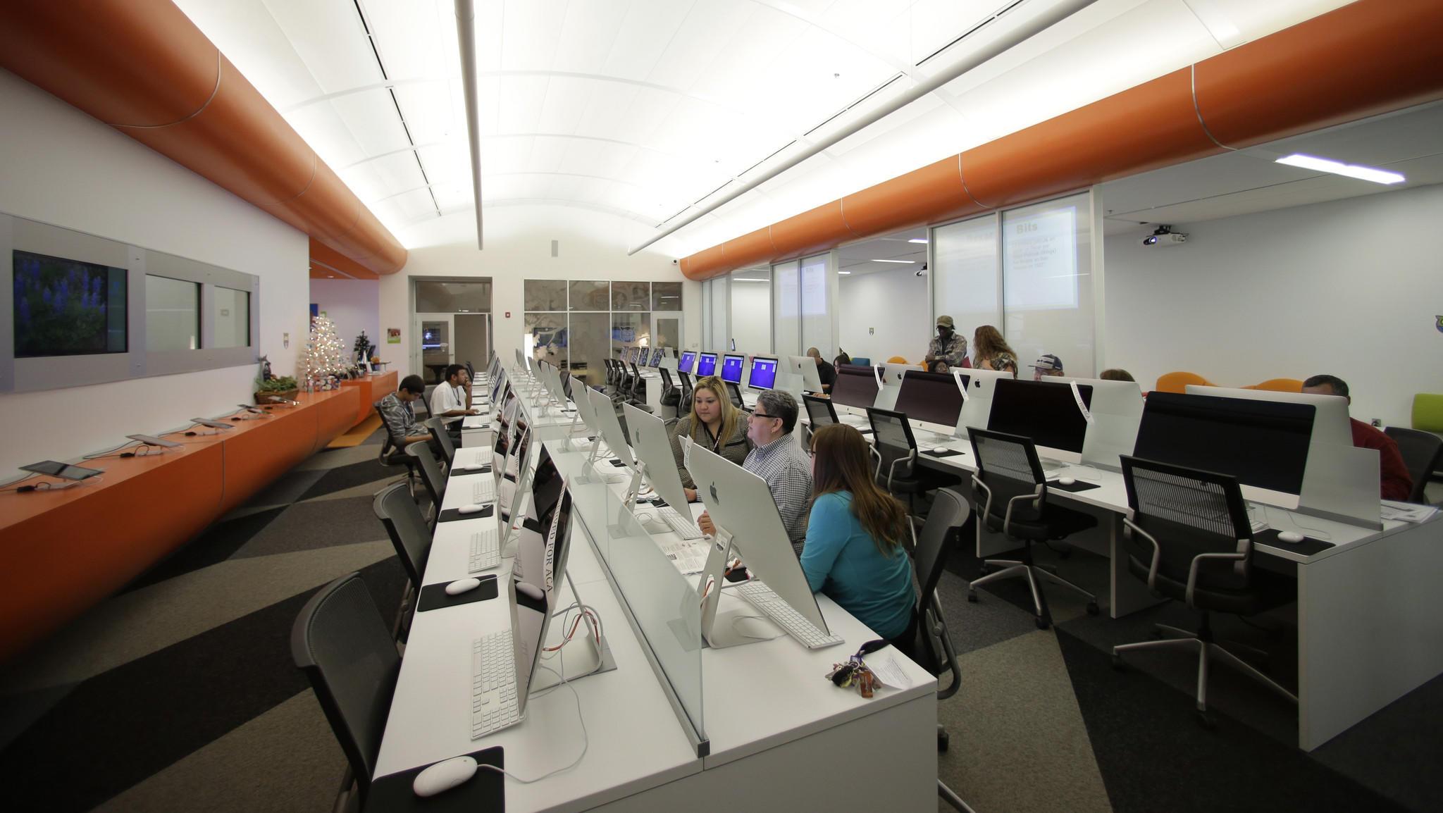 Patrons use computers at BiblioTech, a digital public library in San Antonio, Texas.