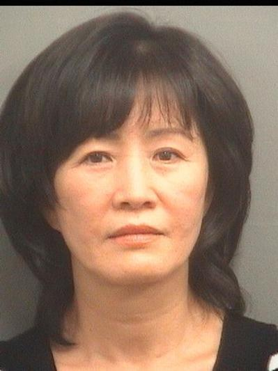 Christina Kim, 55, of New York, was booked in at the Palm Beach County Jail on Jan. 6, 2014. She faces charges of money laundering, deriving support from proceeds of prostitution, and permitting an employee to practice massage without a license.