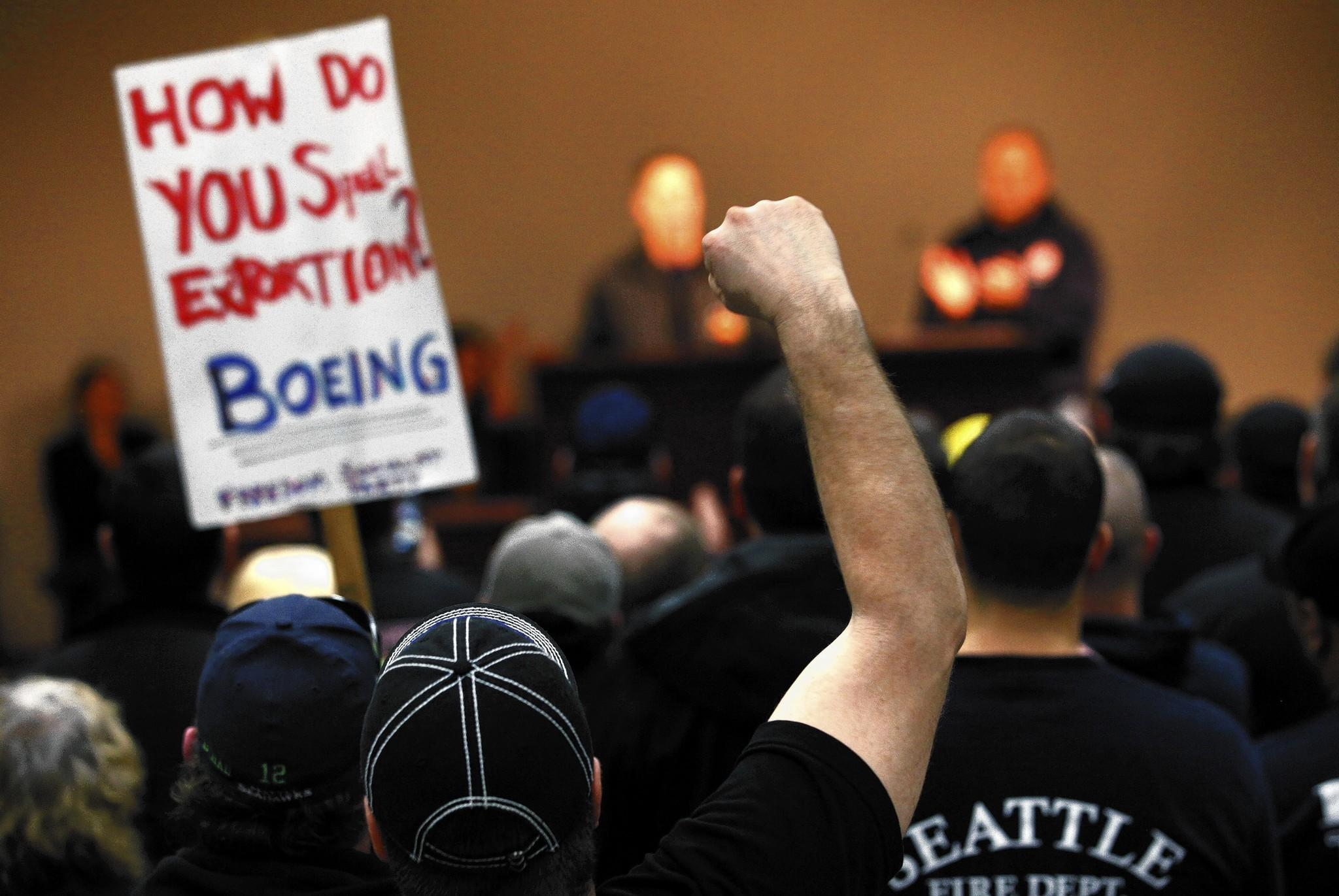 Seattle-area machinist union members rally against a contract with Boeing that included concessions on pensions. In the end, members narrowly approved it after Boeing threatened to take production of the new 777X airliner to another state.