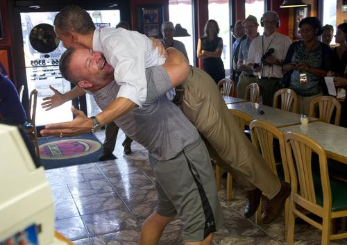 President Obama is picked up by Scott Van Duzer, owner of Big Apple Pizza and Pasta Italian Restaurant, during a campaign visit to the restaurant in Fort Pierce, Fla., on the second day of a two-day bus tour across the state.
