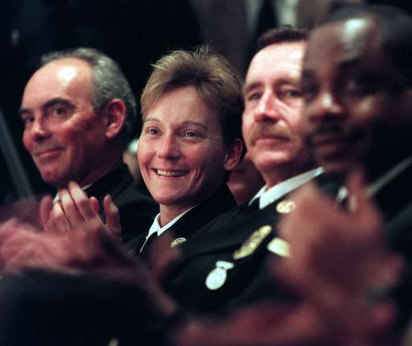 Roxanne Bercik, second from left, at the ceremony where she became the LAFD's first female battalion chief in 1998. She would go on to be the first woman to rise up to the ranks to become deputy chief, a position she will retire from at the end of this month.