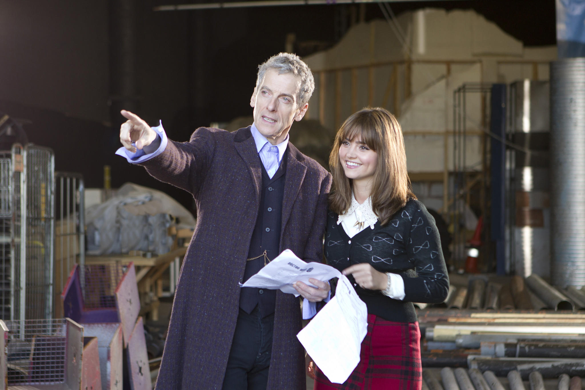 "Peter Capaldi and Jenna Coleman work on the ""Doctor Who"" set in this first image from the ""Capaldi era."""