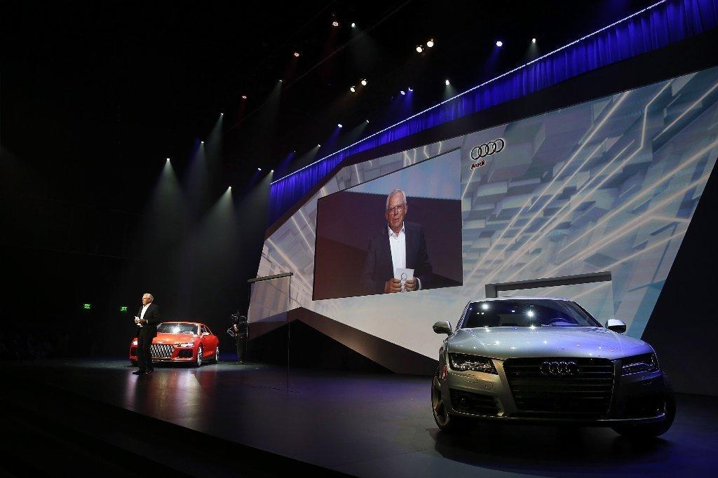 Audi's Ulrich Hackenberg shows off Internet-connected and self-driving cars at CES 2014.