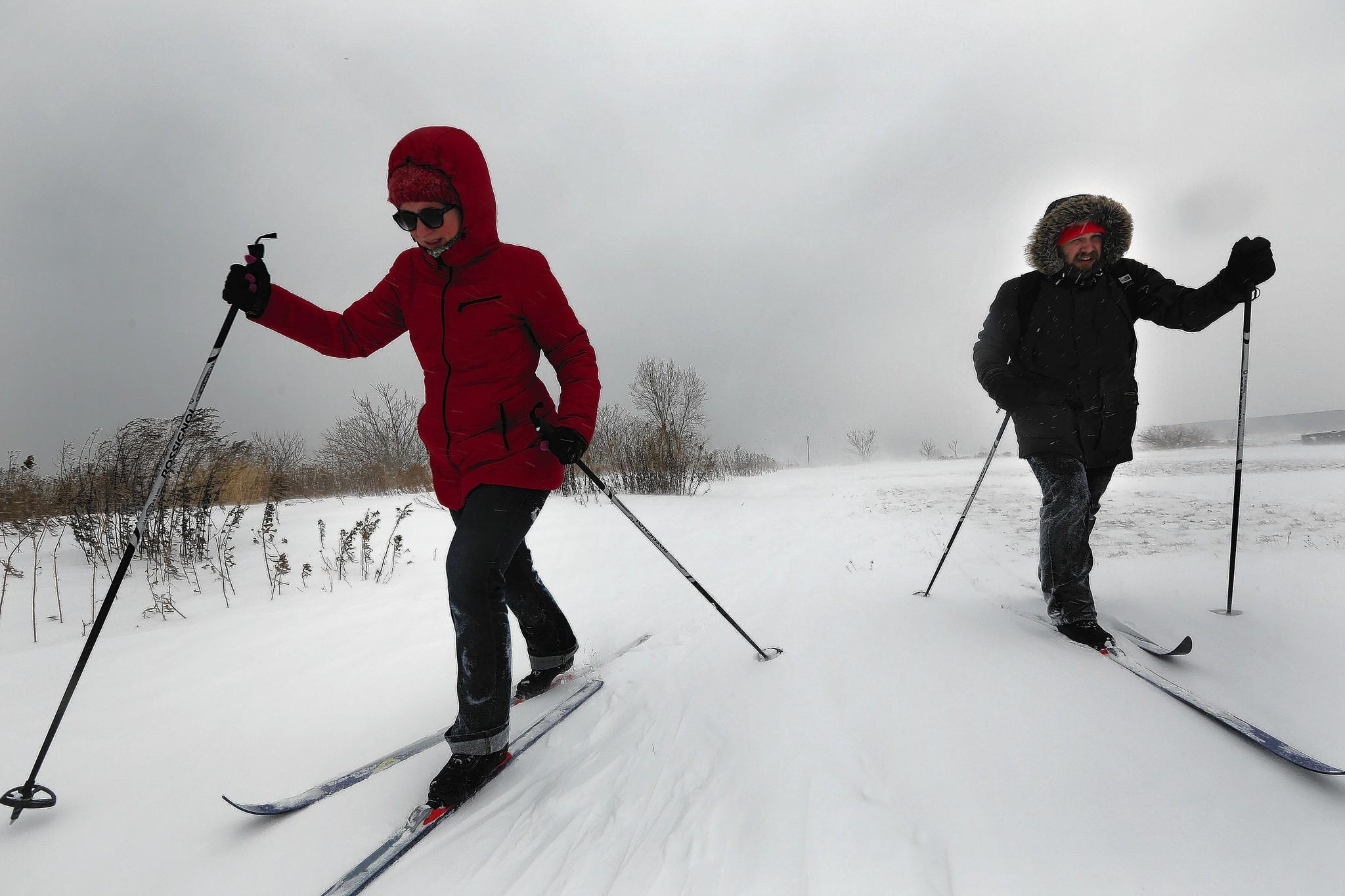 Cross-country skiers Zach Jarrett and Allison McCorkle of Chicago embrace the cold at Chicago's Northerly Island on Sunday. With the proper gear, it doesn't matter how cold it is, say some all-weather exercisers.
