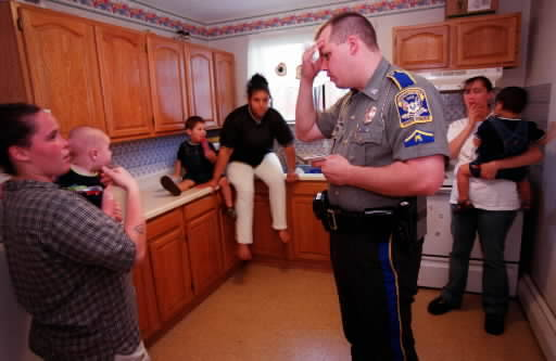 In this file photo, state Trooper Eric Dency deals with a domestic violence call in Windham. Manchester police are taking part in a program meant to help children when their parents are arrested.