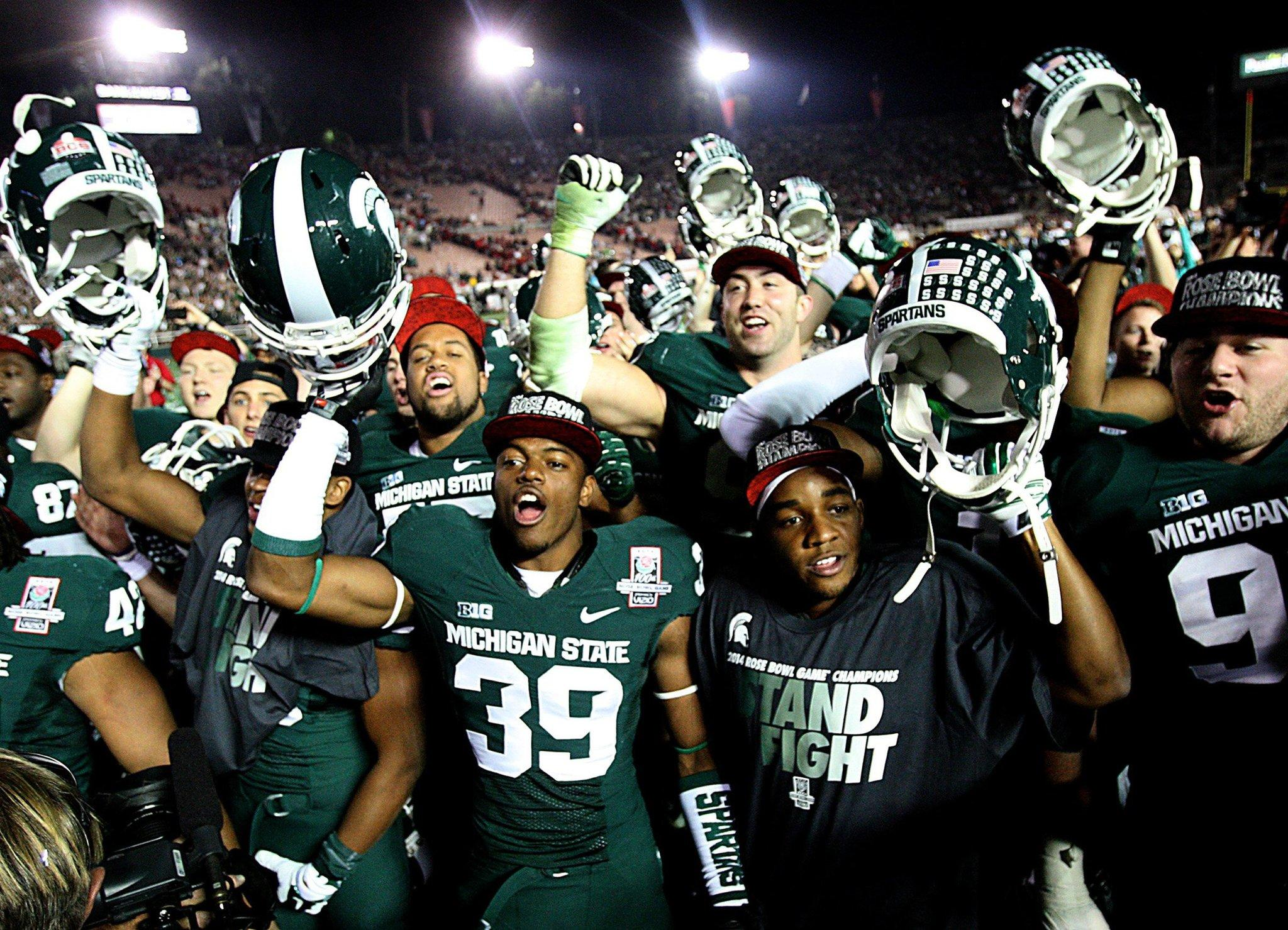 Michigan State players celebrate a 24-20 victory against Stanford in the 100th Rose Bowl in Pasadena, Calif.