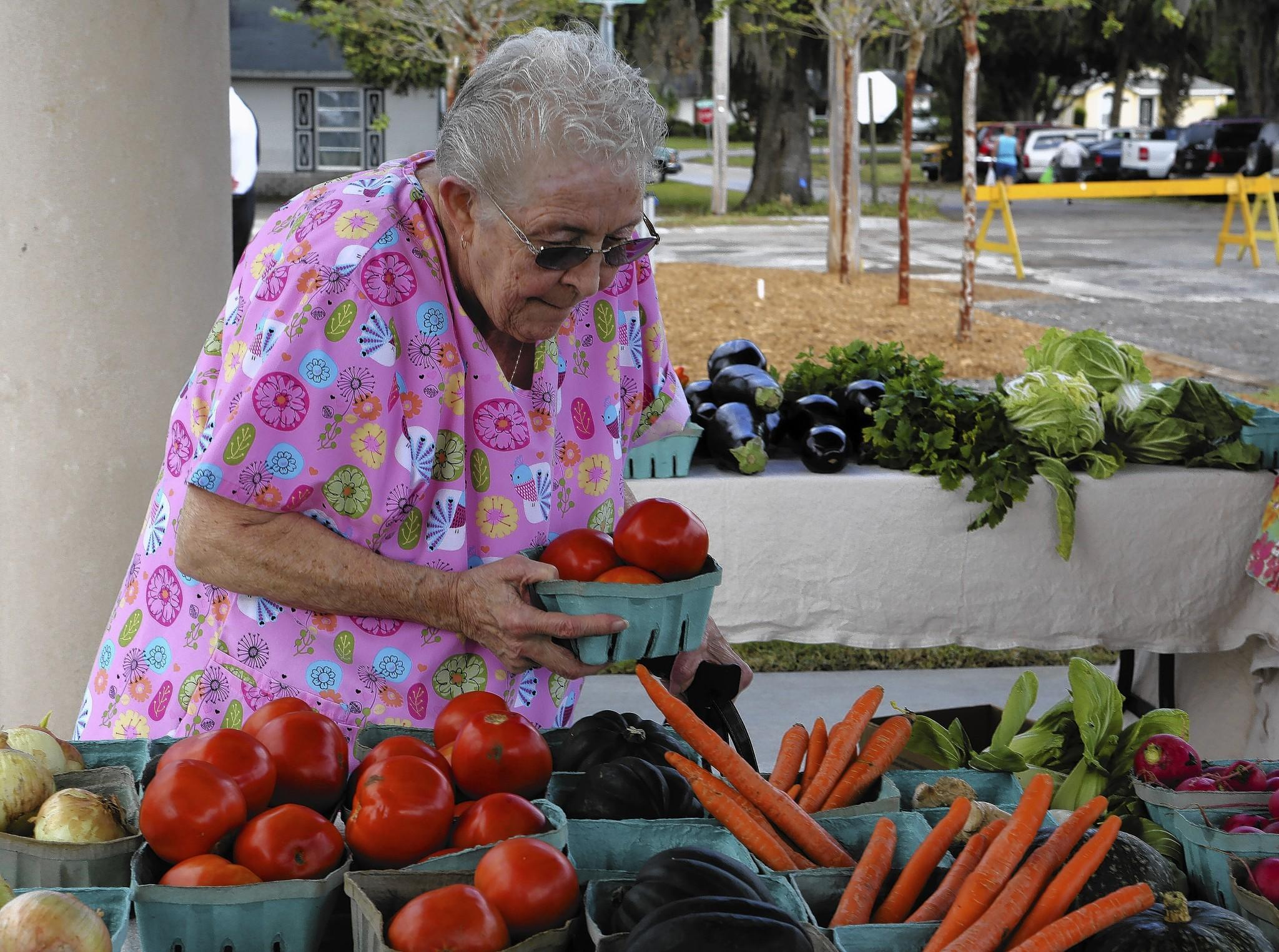 Ruth Verrillya shops for produce at the new open air market at Palmetto Plaza in Eustis on Wednesday, November 6, 2013.