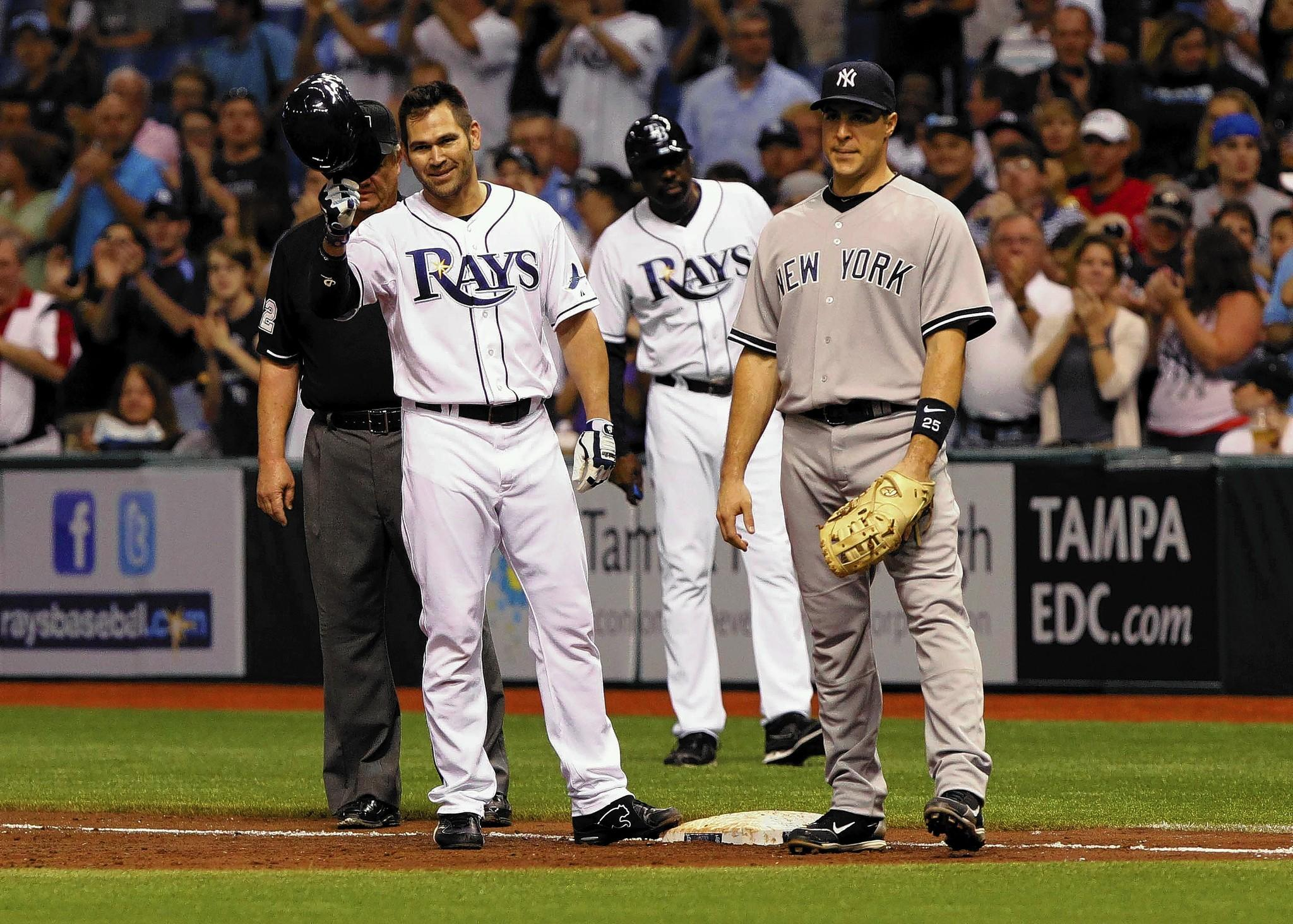 September 27, 2011; St. Petersburg, FL, USA; Tampa Bay Rays designated hitter Johnny Damon (22) reacts to fans after passin Lou Gehrig on the all-time hit list with 2,722 hits in the second inning against the New York Yankees at Tropicana Field. Mandatory Credit: Kim Klement-US PRESSWIRE ORG XMIT: USPW-31716 ** Usable by BS, CT, DP, FL, HC, MC, OS and HOY **