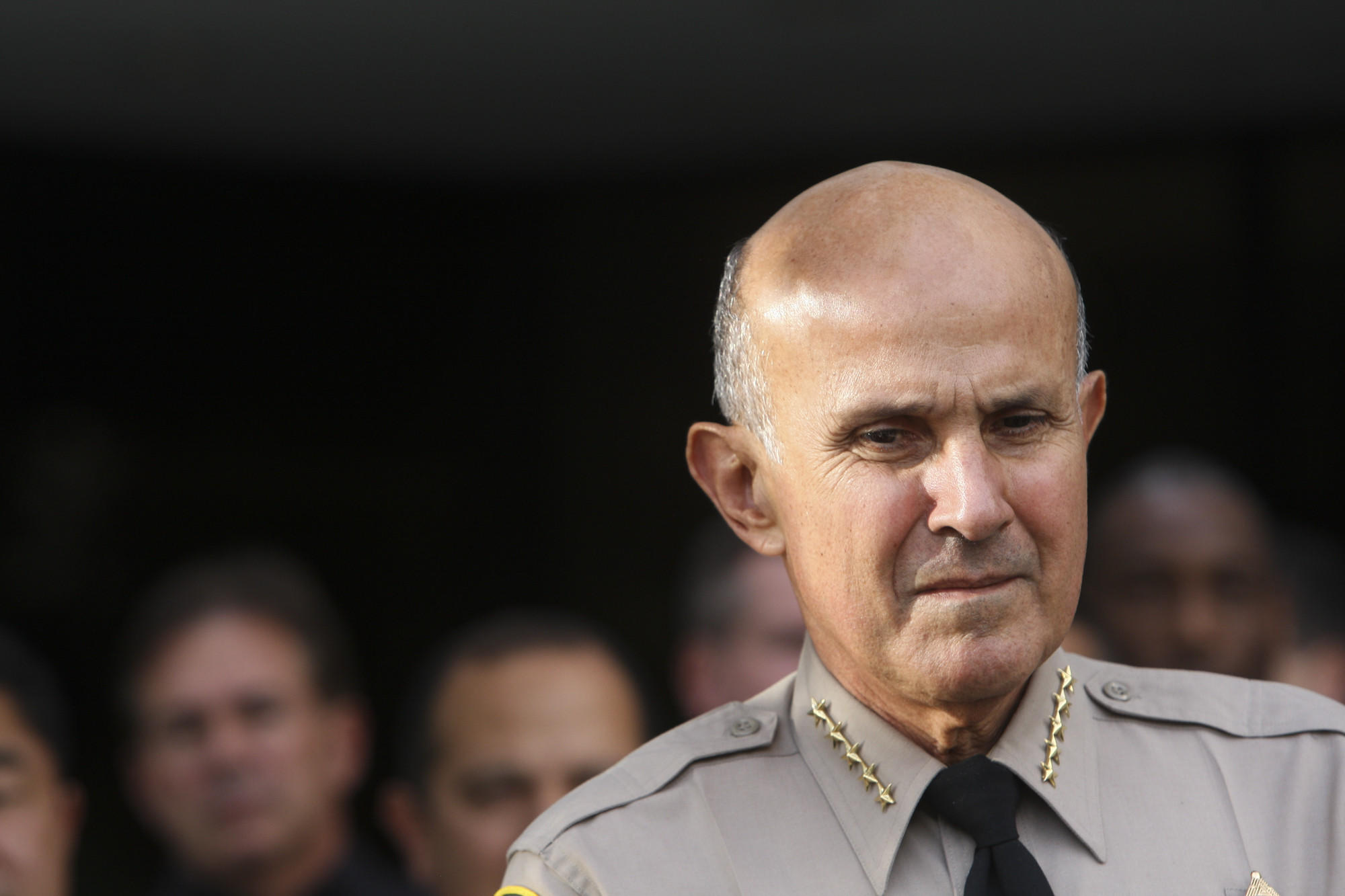 File Photo: Sheriff Lee Baca speaks during a toy drive outside of sheriff's headquarters building in Monterey Park on Monday, December 16, 2013. The drive was held by the Los Angeles Country Sheriff's Department and the Fred Jordan Mission. Baca announced on Tuesday, Jan. 7, 2014, that he would retire at the end of the month.