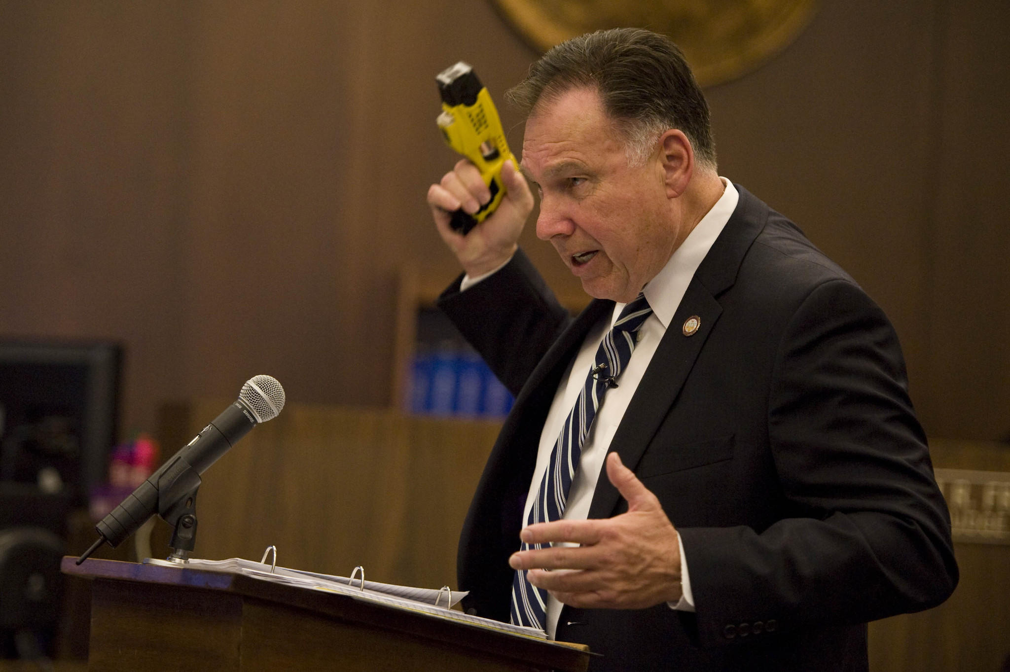 Orange County District Attorney Tony Rackauckas holds up a stun gun similar to the one used to beat Kelly Thomas.