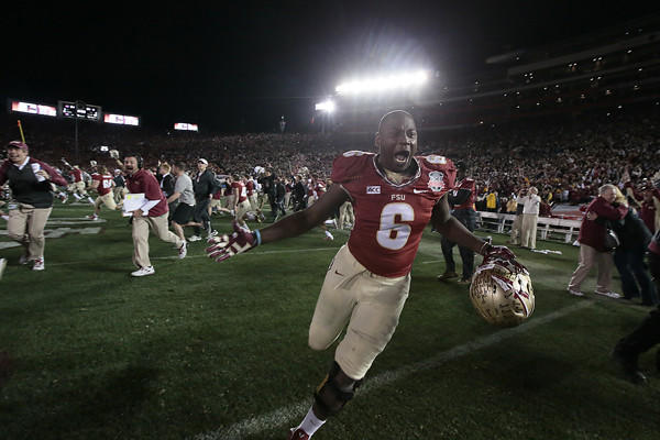 Florida State defensive end Dan Hicks storms the field in celebration immediately after the Seminoles' 34-31 victory over Auburn in the BCS championship game Monday at the Rose Bowl.
