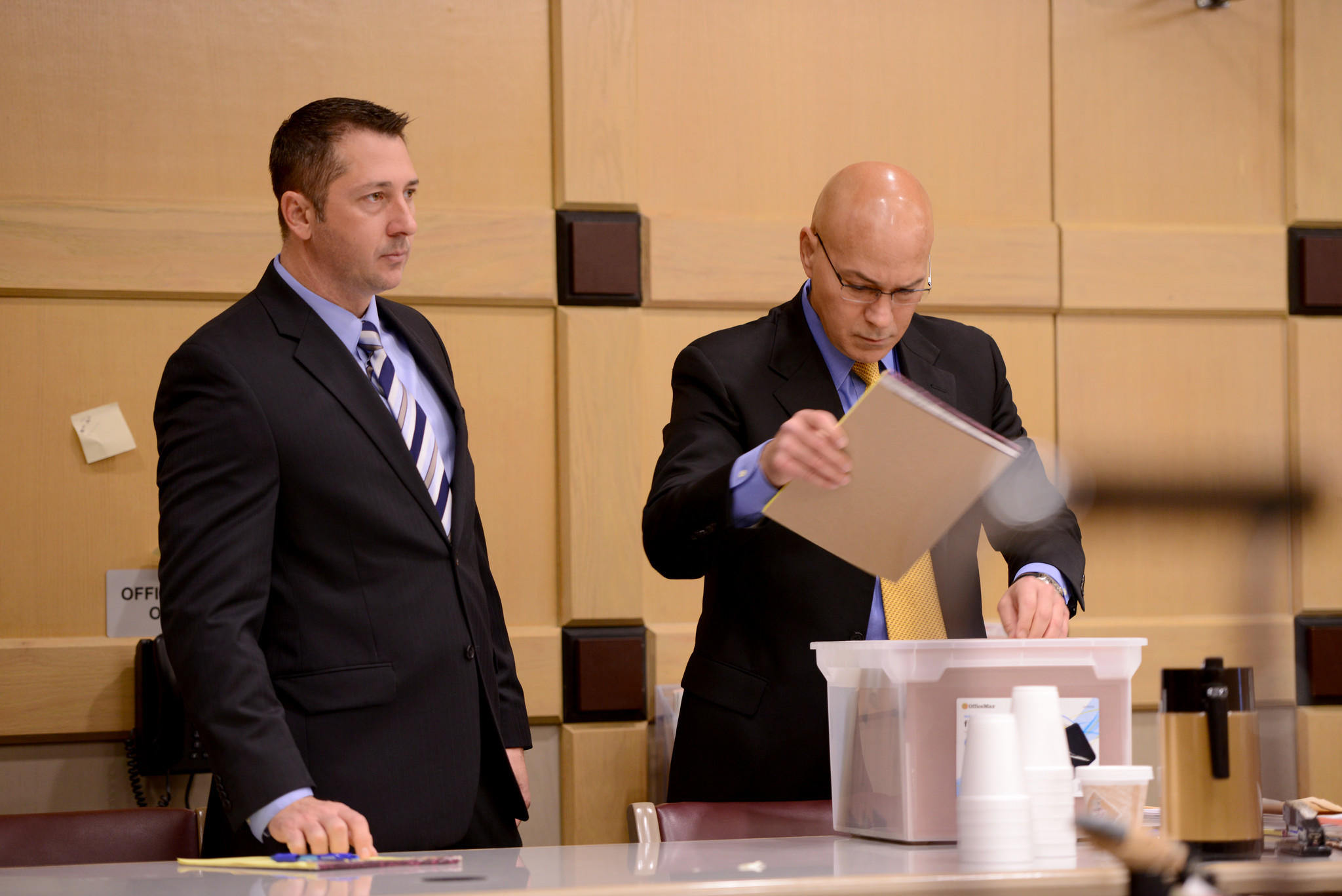 Paul Pletcher, left, the BSO deputy fired in 2012 after a road rage incident was recorded by cellphone, stands next to his attorney Al Milian before his trial begins Tuesday in Fort Lauderdale.