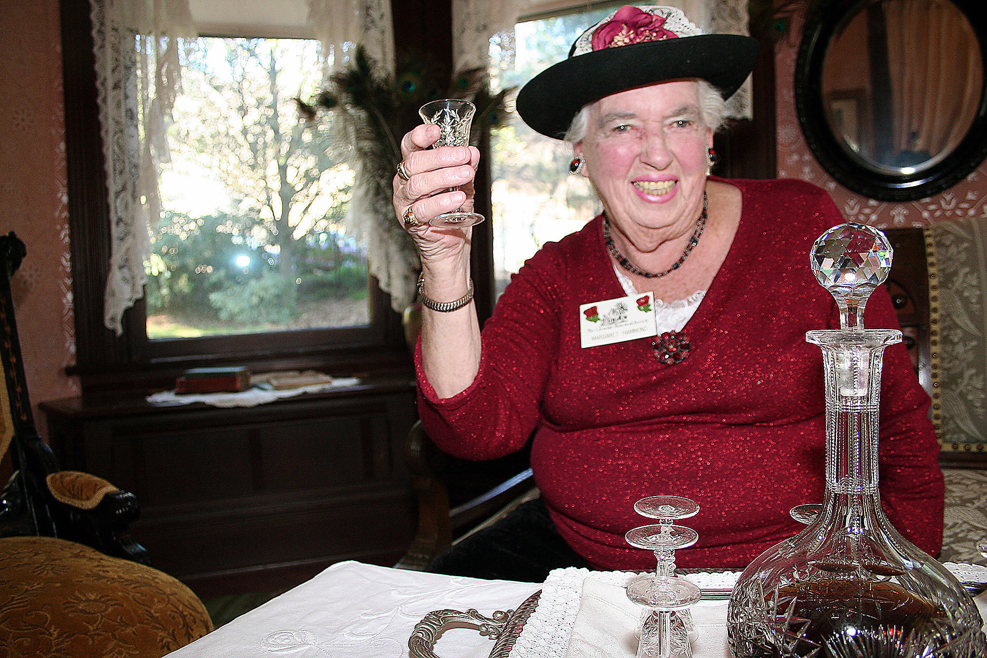 Volunteer greeter and Glendale Historical Society board member Margaret Hammond toasts the new year in the dining room of the Doctors House Museum in Brand Park.