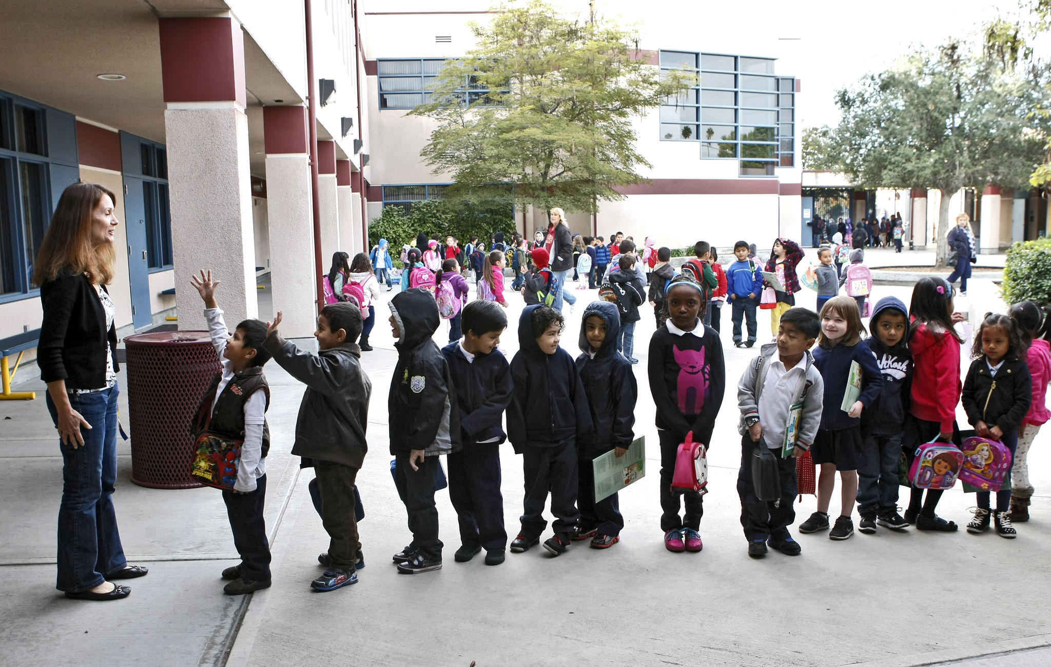Teacher Ms. Angela Boras prepares to take her students into class at Cerritos Elementary School in Glendale on Tuesday, January 7, 2014. The school is one of three in the Glendale Unified School District to be eligible to earn a California Distinguished School award.