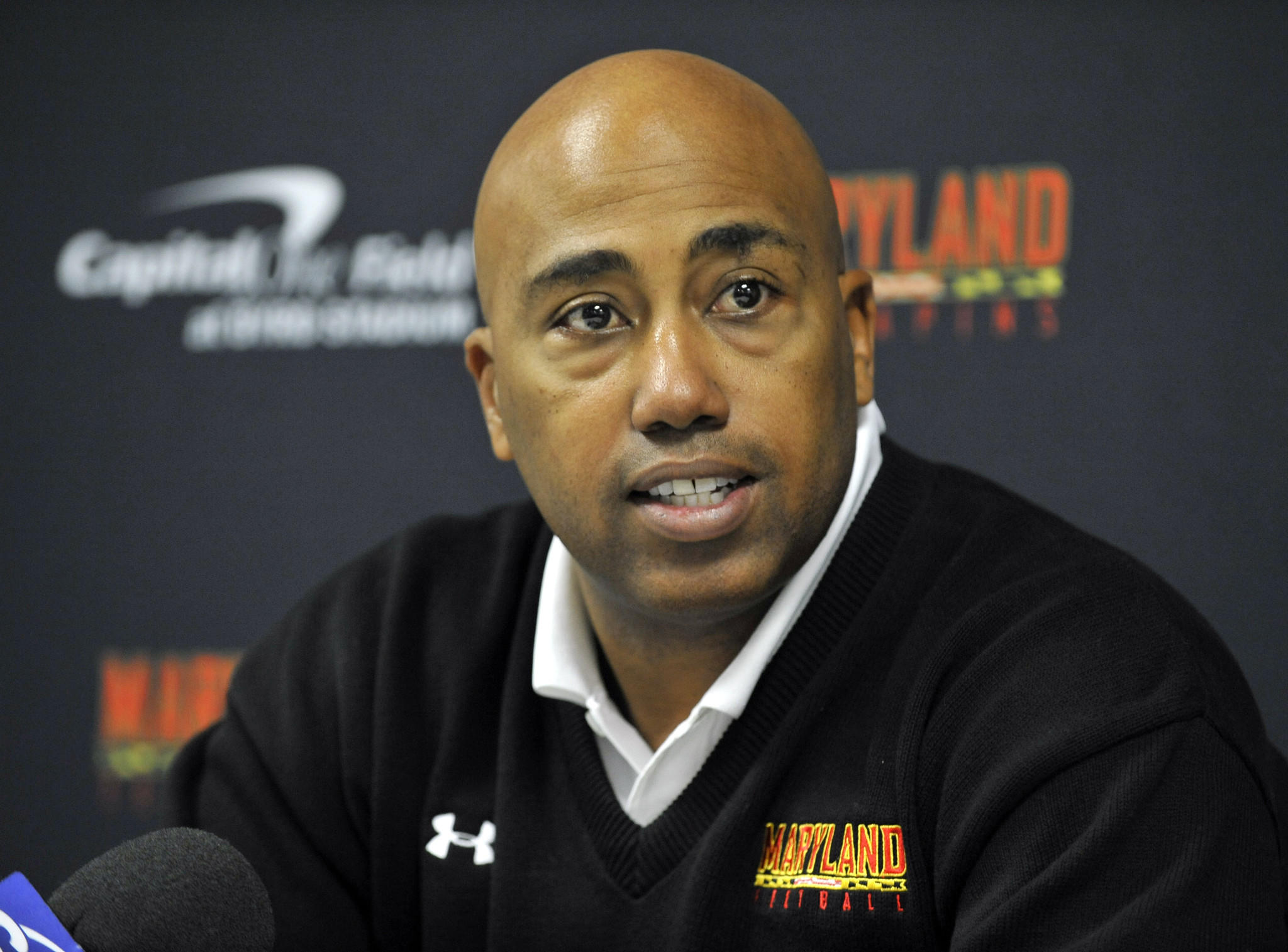 Maryland defensive coordinator Brian Stewart speaks to the media in February 2012.