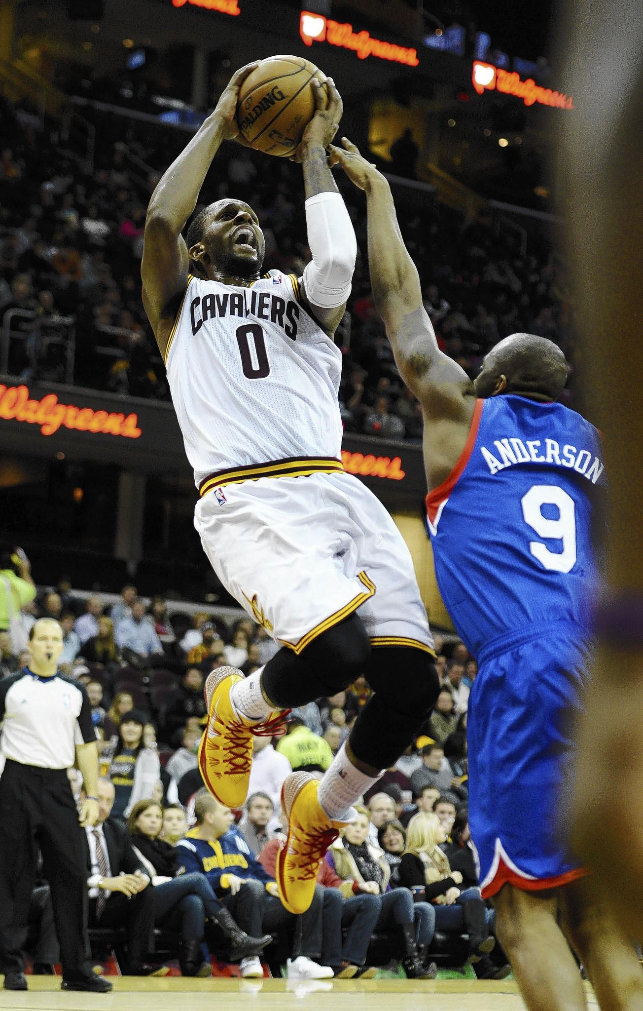 Jan 7, 2014; Cleveland, OH, USA; Cleveland Cavaliers shooting guard C.J. Miles (0) shoots over Philadelphia 76ers shooting guard James Anderson (9) during the game at Quicken Loans Arena. **