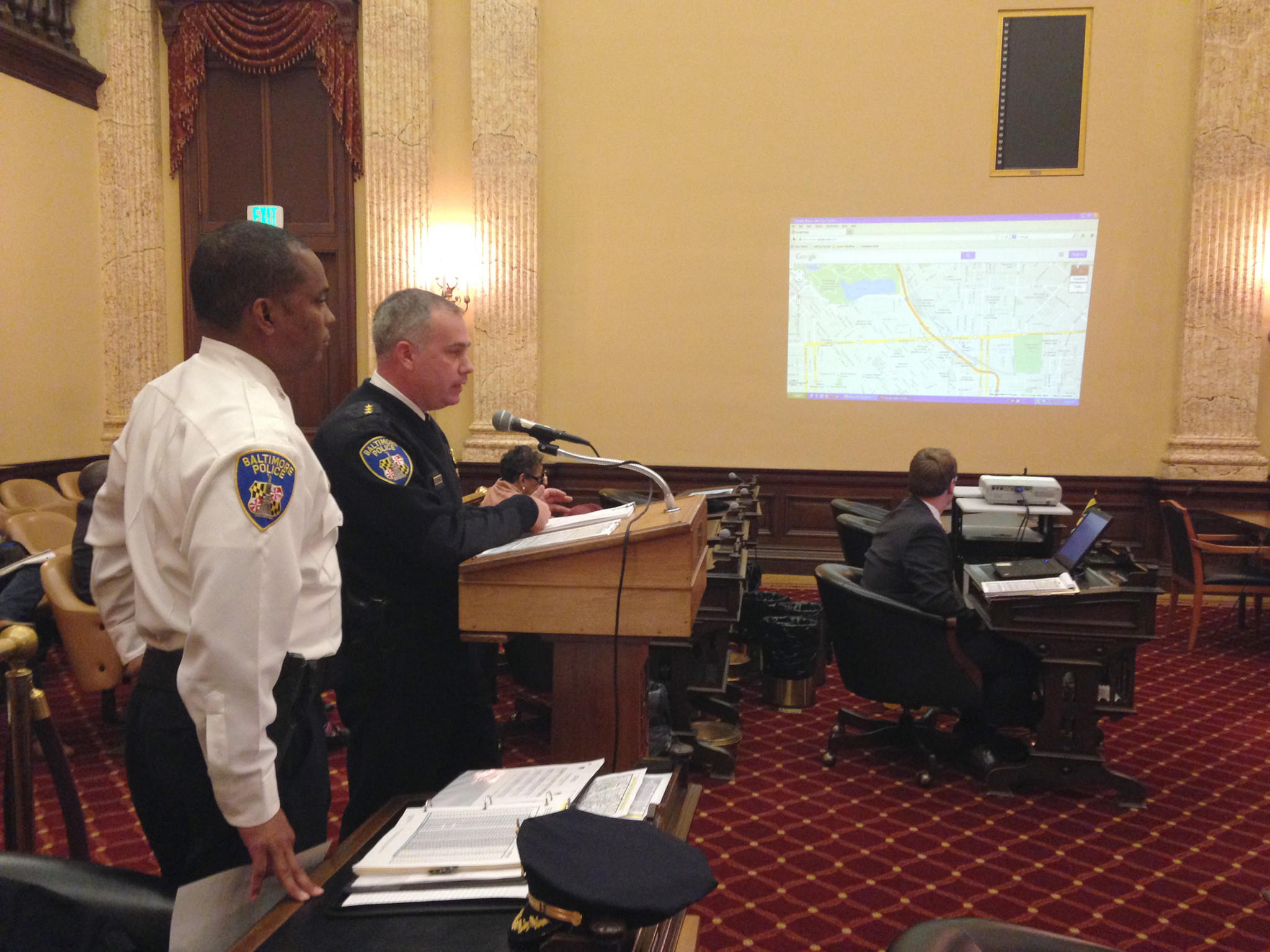 Col Darryl DeSousa, left, and Deputy Commissioner John Skinner go over crime trends at a City Council oversight hearing Tuesday.