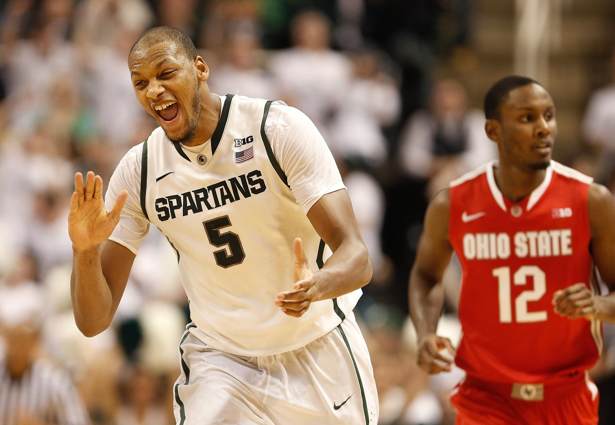 Adreian Payne reacts to a three-point shot he hit in overtime in front of Ohio State's Sam Thompson.