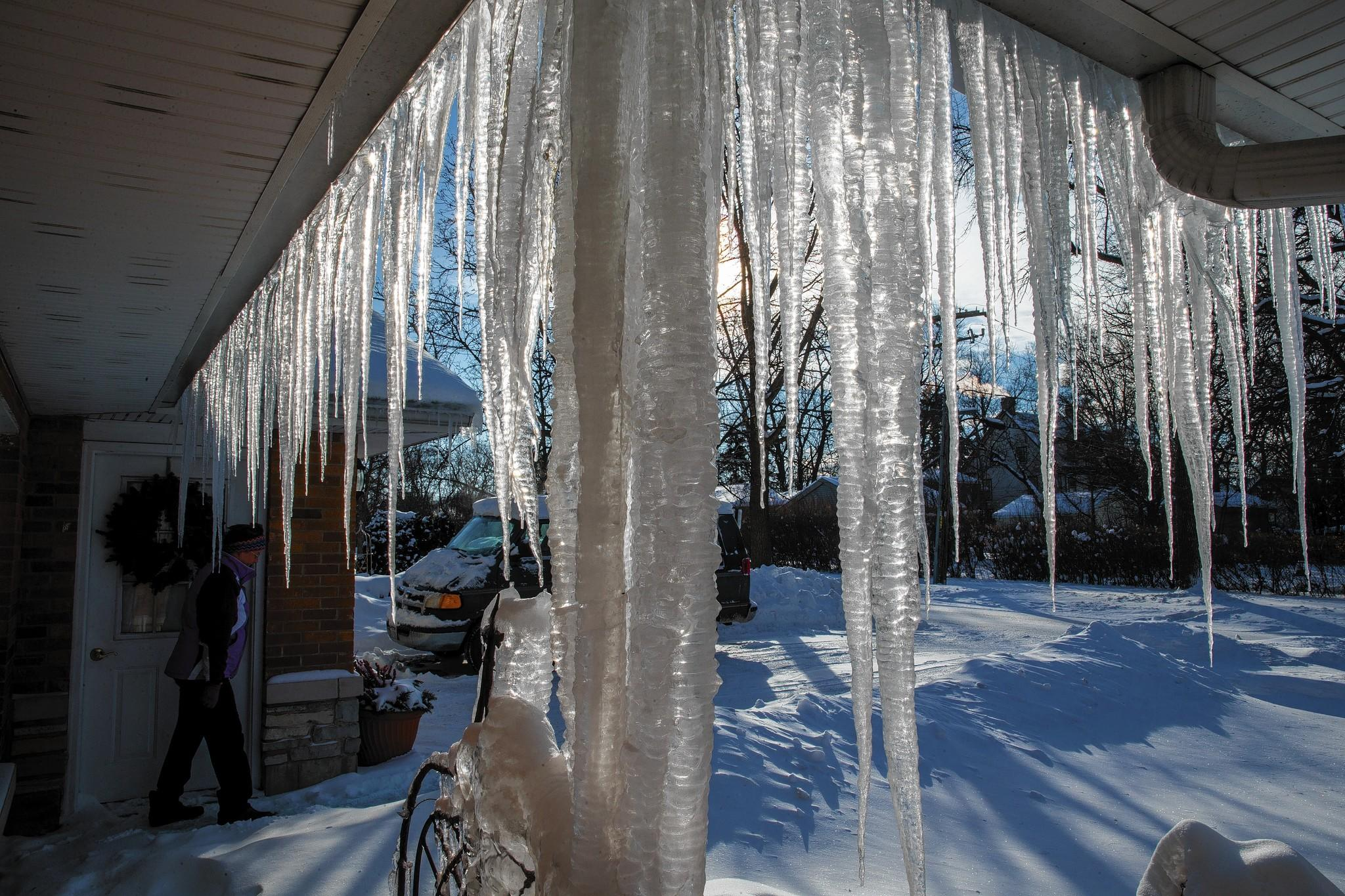 Ice that builds up on the roofs of homes from melting snow can cause damming that can damage gutters and roofs and send water into houses.