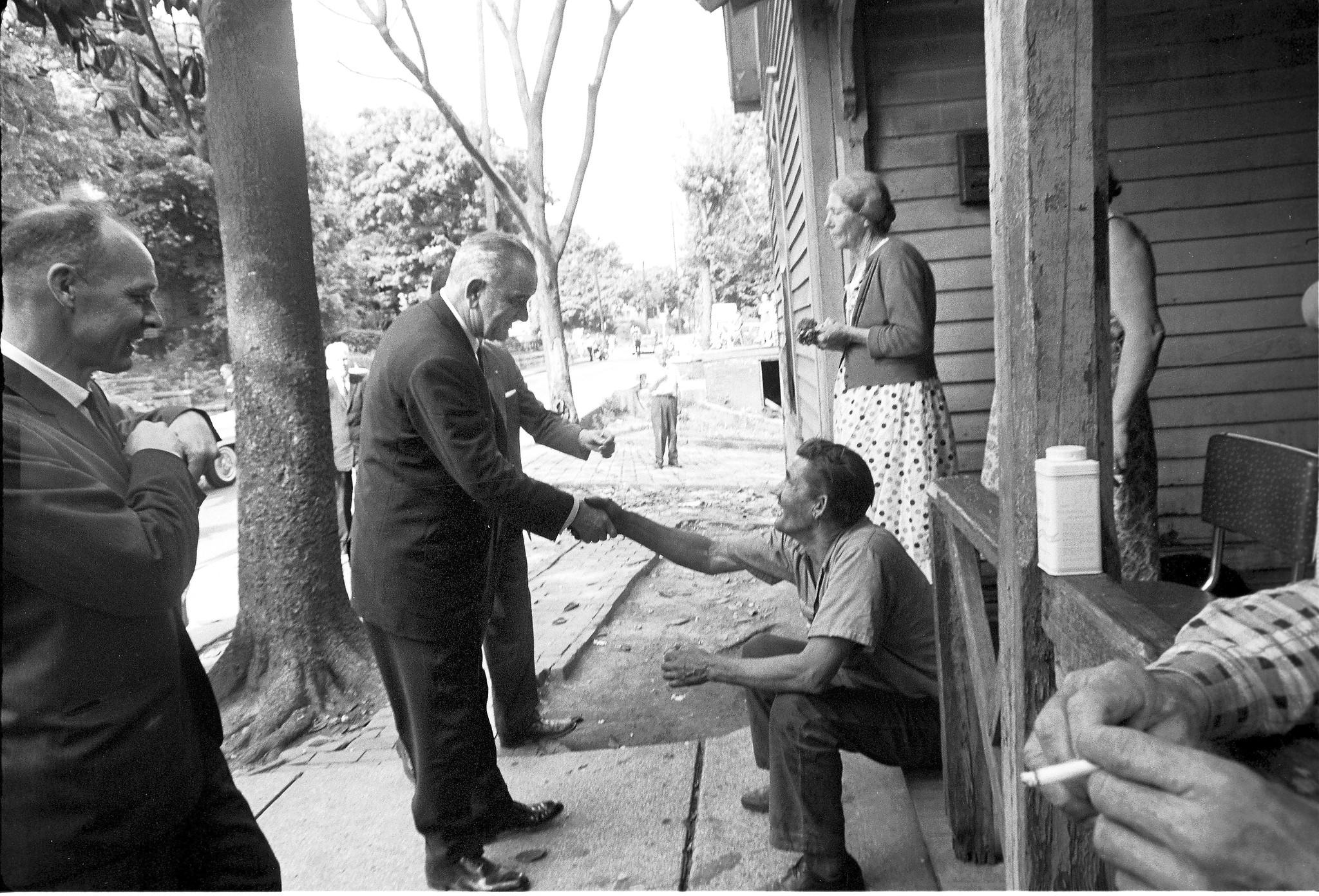 "President Lyndon B. Johnson shakes the hand of one of the residents of Appalachia, where the ""War on Poverty"" was waged in the 1960s."