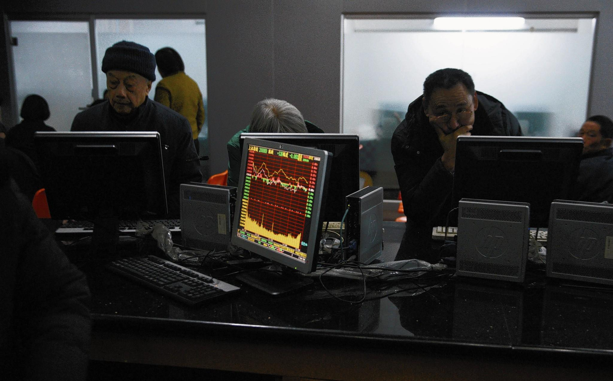 Investors monitor stocks in China, where an unsettled economy could provide reason for concern in 2014.