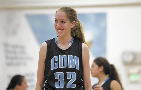 Corona del Mar High's Natalia Bruening smiles after drawing a foul during a game against Newport Harbor on Tuesday.