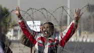 Egyptian authorities postpone Morsi trial