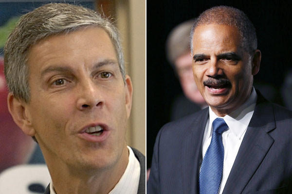 Education Secretary Arne Duncan (left) and U.S. Attorney General Eric Holder