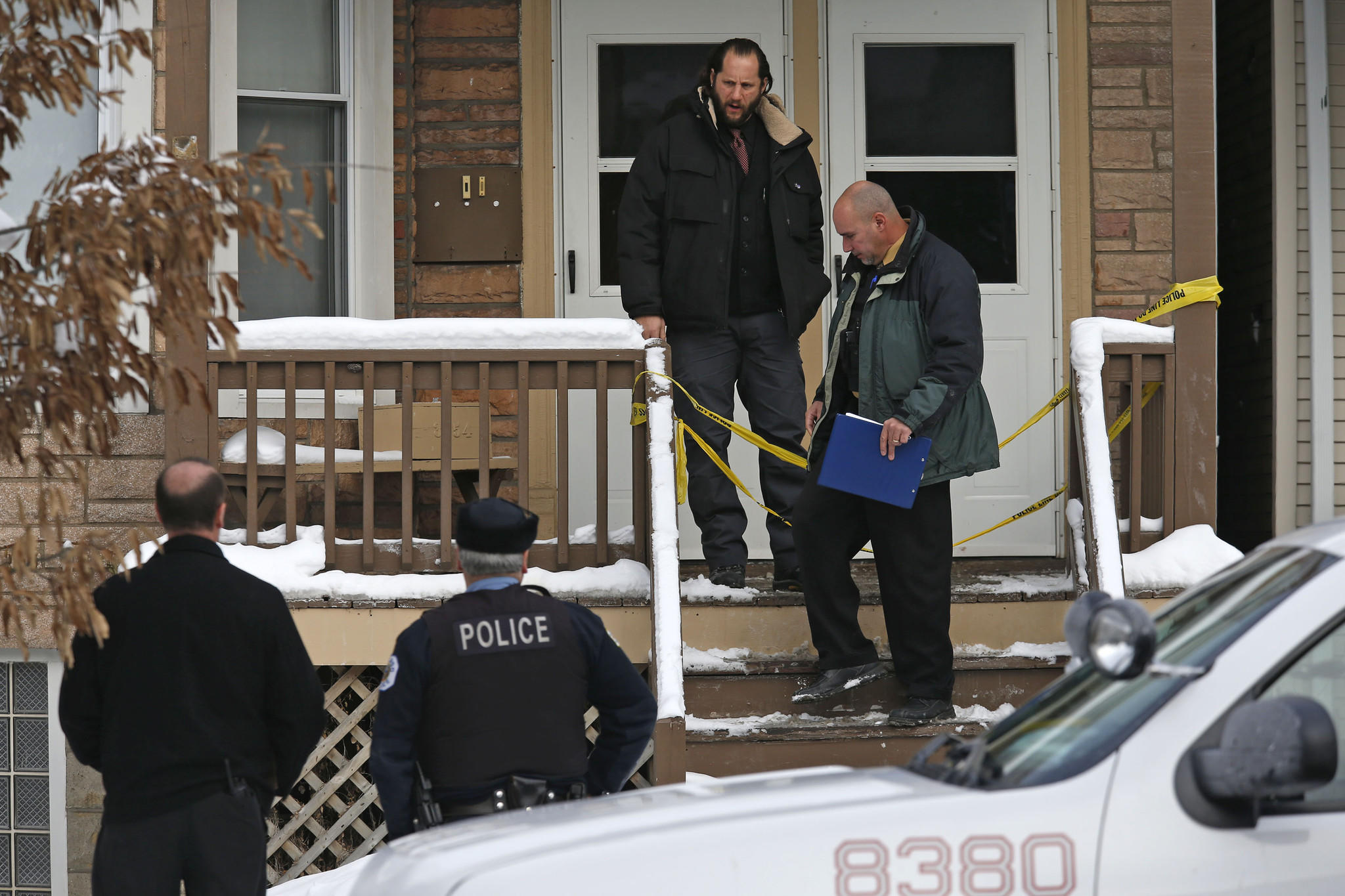 Chicago Police investigators exit the two-flat building in the 3500 block of West Wrightwood Avenue in Chicago on Wednesday where contractors found a human skull.