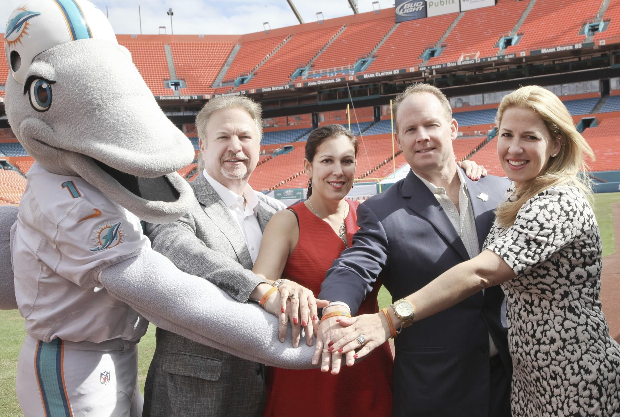 "Left to right, T.D. Gerry Greenspoon, Rosy Lopez, Jeff Ireland and Maylynn Menoud promote the Dan Marino Foundation ""Walkabout Autism & Expo,"" which takes place on Saturday, Jan. 25, 2014 from 9 a.m. to 1 p.m. at Sun Life Stadium in Miami."