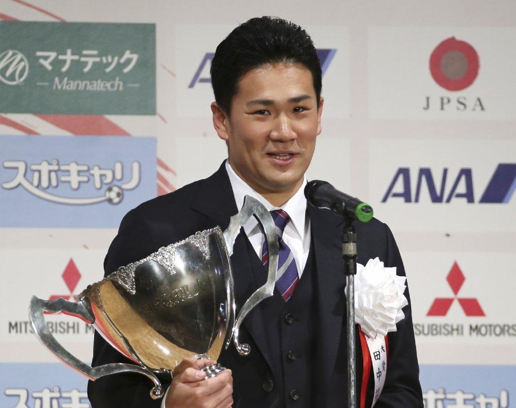 Japanese star pitcher Masahiro Tanaka poses with his grand prix trophy.