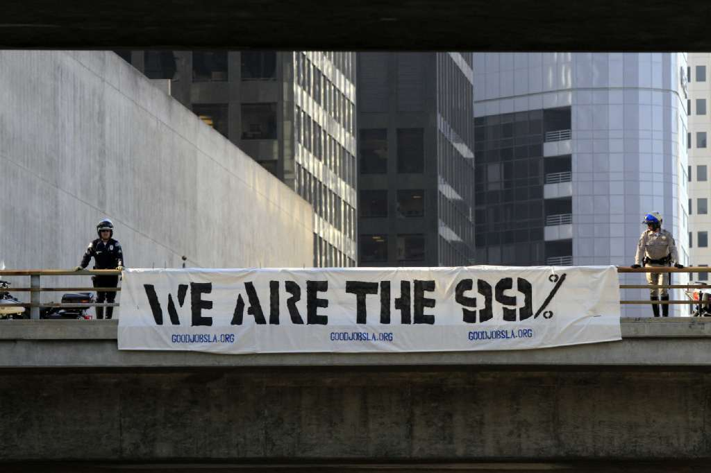 "Is it ""rebellious"" for young millennials to express concern over the nation's growing income inequality? Above, a protest banner in downtown Los Angeles in 2011."