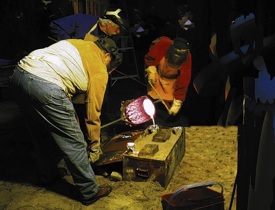 "Pouring molten bronze at Crealde School of Art's ""Night of Fire""."