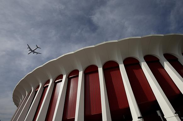 A plane flies over the Forum in Inglewood, which has recently undergone major renovations as new ownership and management strive to make the famed facility the premier live music venue in Southern California.