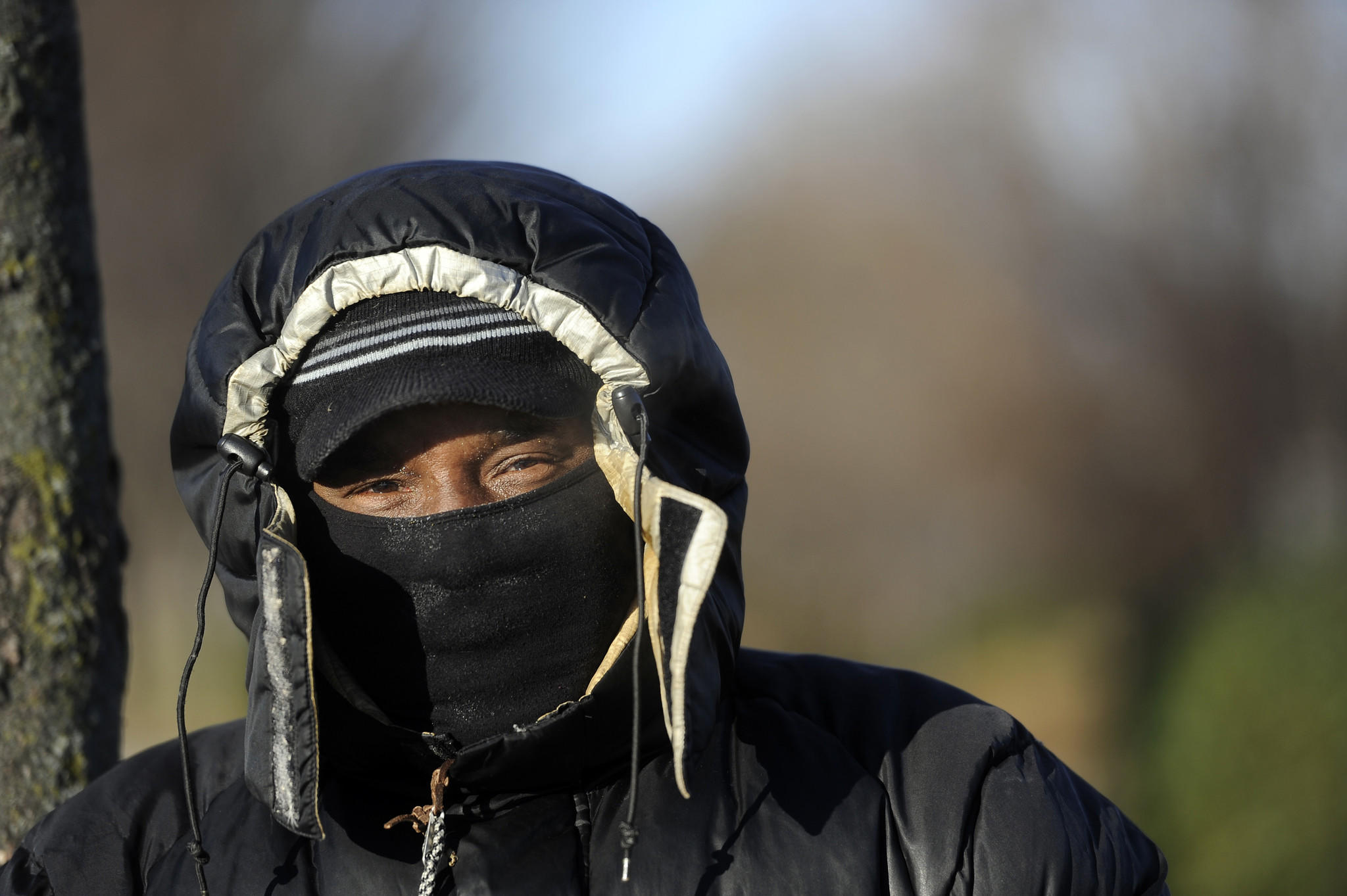 A bundled-up Gilbert Weems of Baltimore waits for a bus on 33rd Street.