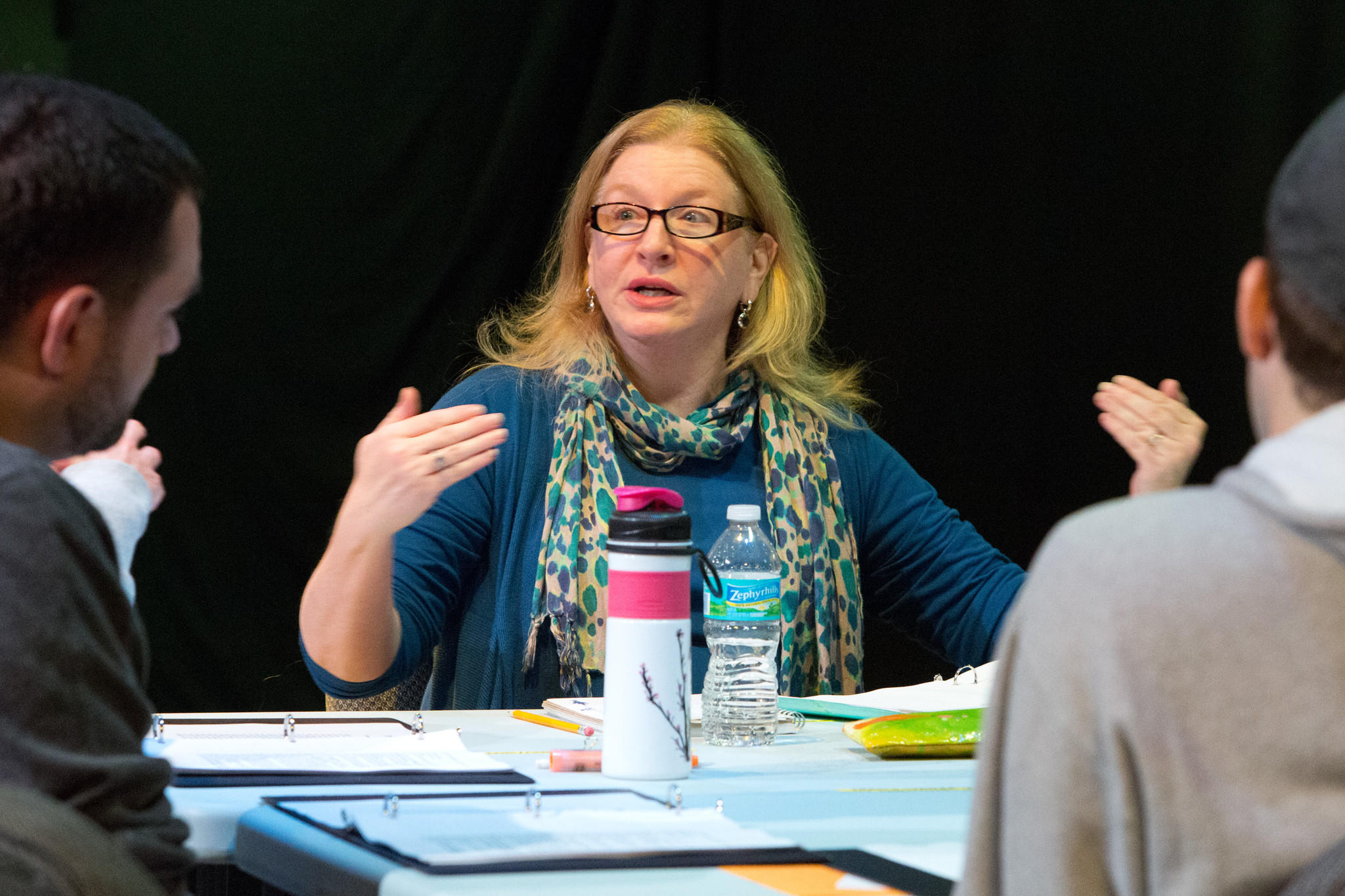 "Director Denise Gillman works with actors Stephen Lima and Chris McCabe (from left, with backs to camera) during rehearsal of ""Photograph 51,"" part of Mad Cow Theatre's Science-Play Festival."