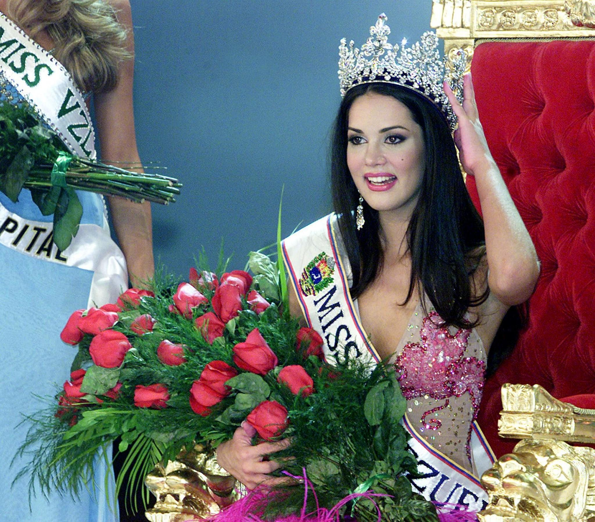 Venezuelan Monica Spear poses after being elected Miss Venezuela, in Caracas, on September 23, 2004. Former beauty queen turned soap opera star Monica Spear was found shot to death on January 6, 2014 with her husband in their car on a roadside in Venezuela, local media reported on January 7. Spear's five-year-old daughter was found alive in the car on Monday night and was in stable condition after being treated at a medical center, Venezuelan authorities said. Authorities confirmed that Spear, 29, and her husband Thomas Henry Berry, 39, were found dead Monday night inside their car on a highway linking the cities of Puerto Cabello and Valencia.