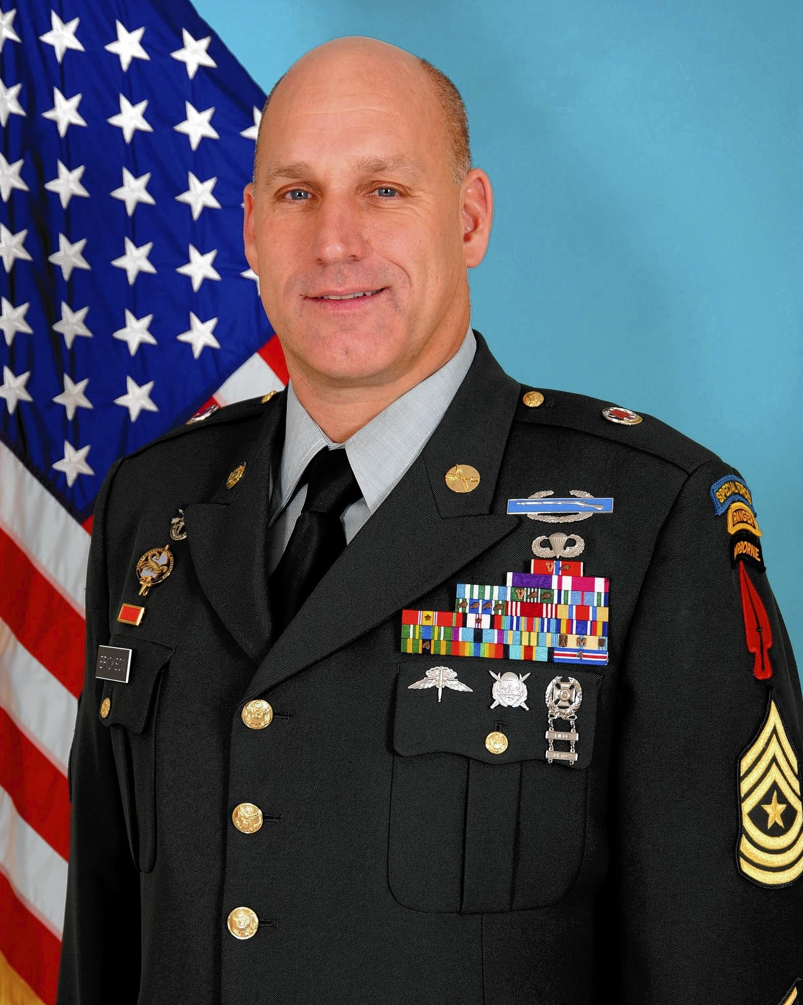 Sgt. Maj. Richard Erickson was awarded reinstatment and back pay after being fired by the Postal Service while serving overseas in the National Guard in 2000.