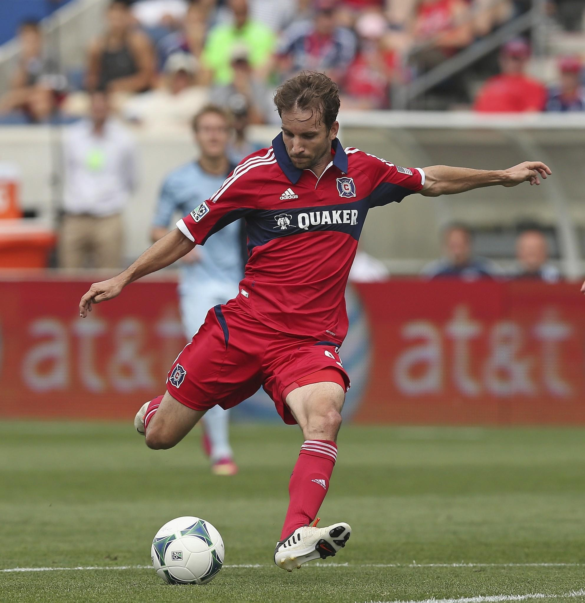 Mike Magee scores a first half goal against Sporting Kansas City during an MLS match at Toyota Park.
