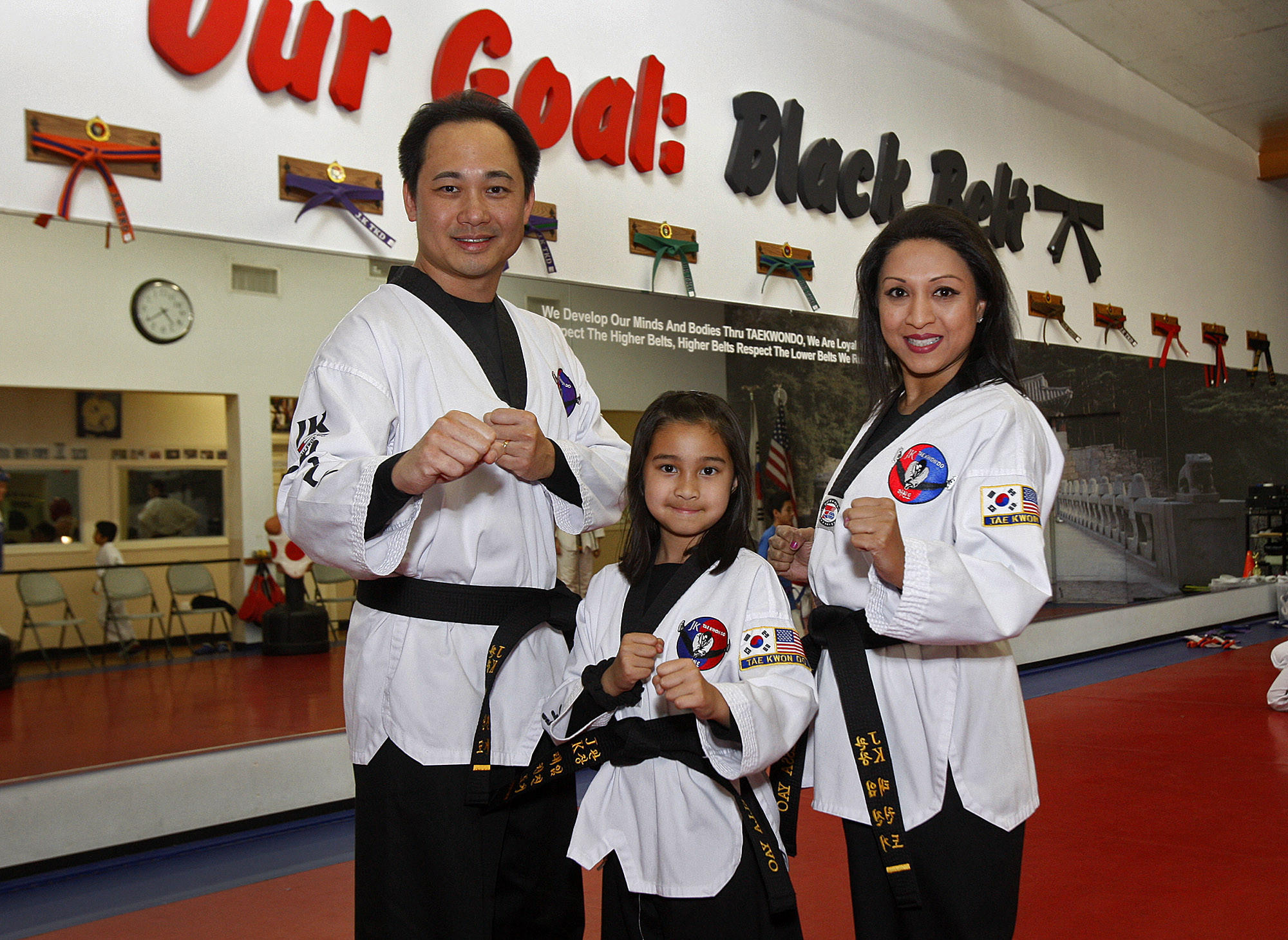 Hugh, Stella, 9, and Tessa Yao, all first degree black belts, at JK Tai Kwon Do in Glendale on Tuesday, January 7, 2014. The three became black belts in December after completing a 7 hour advancement test, ending the test by breaking, with their hands, a block of concrete.