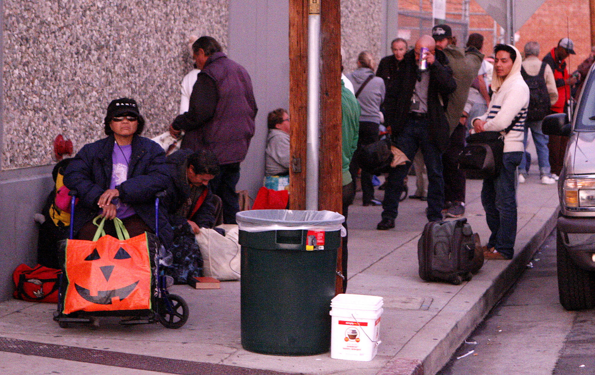People wait in line for the shelter to open at Ascencia in Glendale for the Glendale Winter Shelter Program on Monday, December 2, 2013.