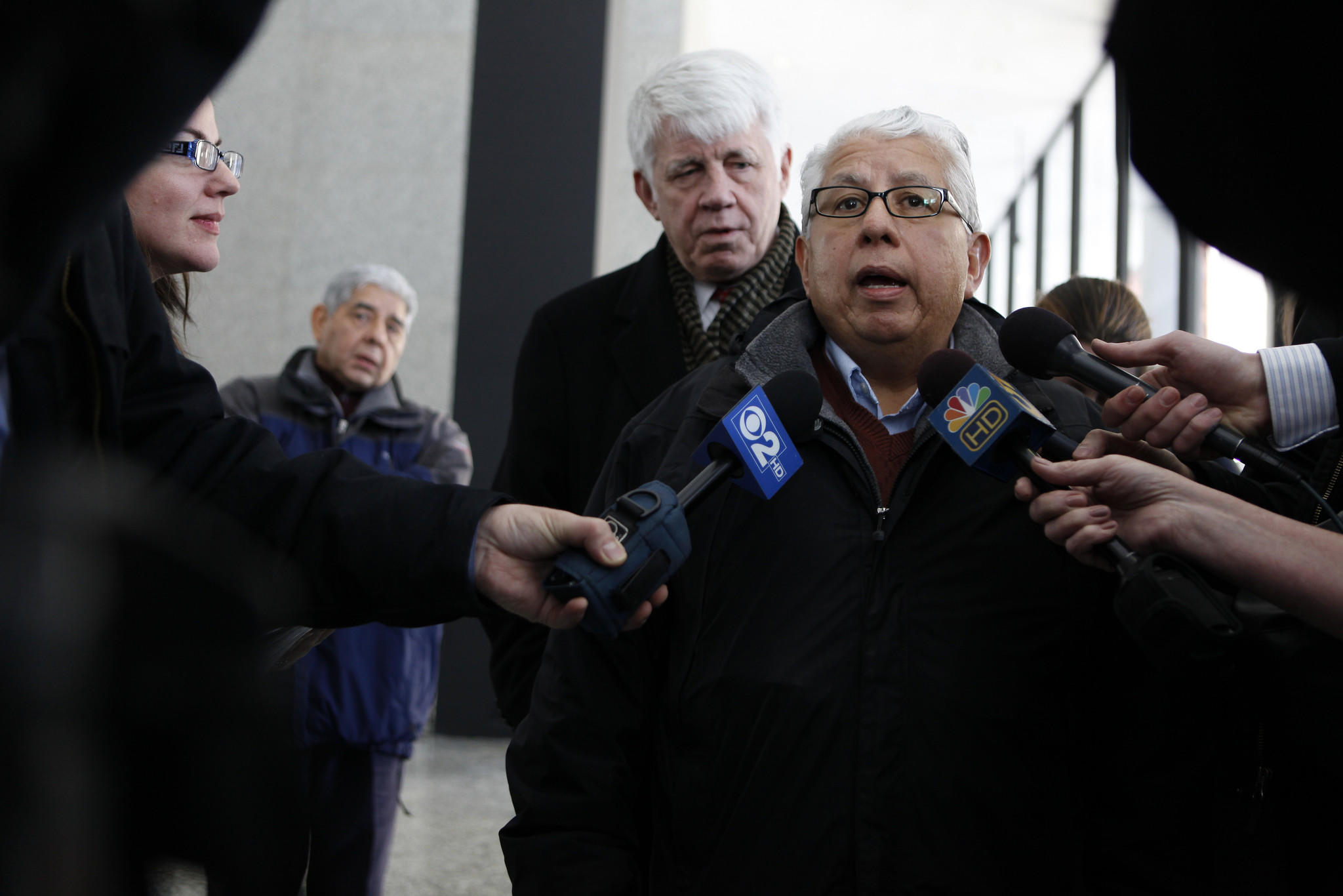 Al Sanchez, right, and his attorney Tom Breen, talk to the media following his sentencing seen here at the Dirksen U.S. Courthouse in Chicago on Thursday, February 3, 2011