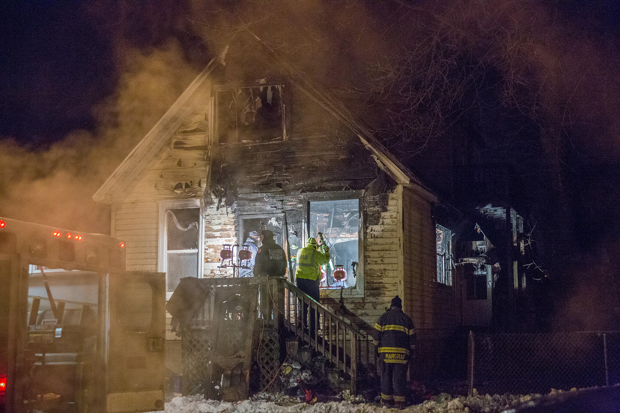 Fire investigators at the scene of the fire in the 600 block of Sibley Street in Hammond, Ind. on Thursday, Jan. 9, 2014.