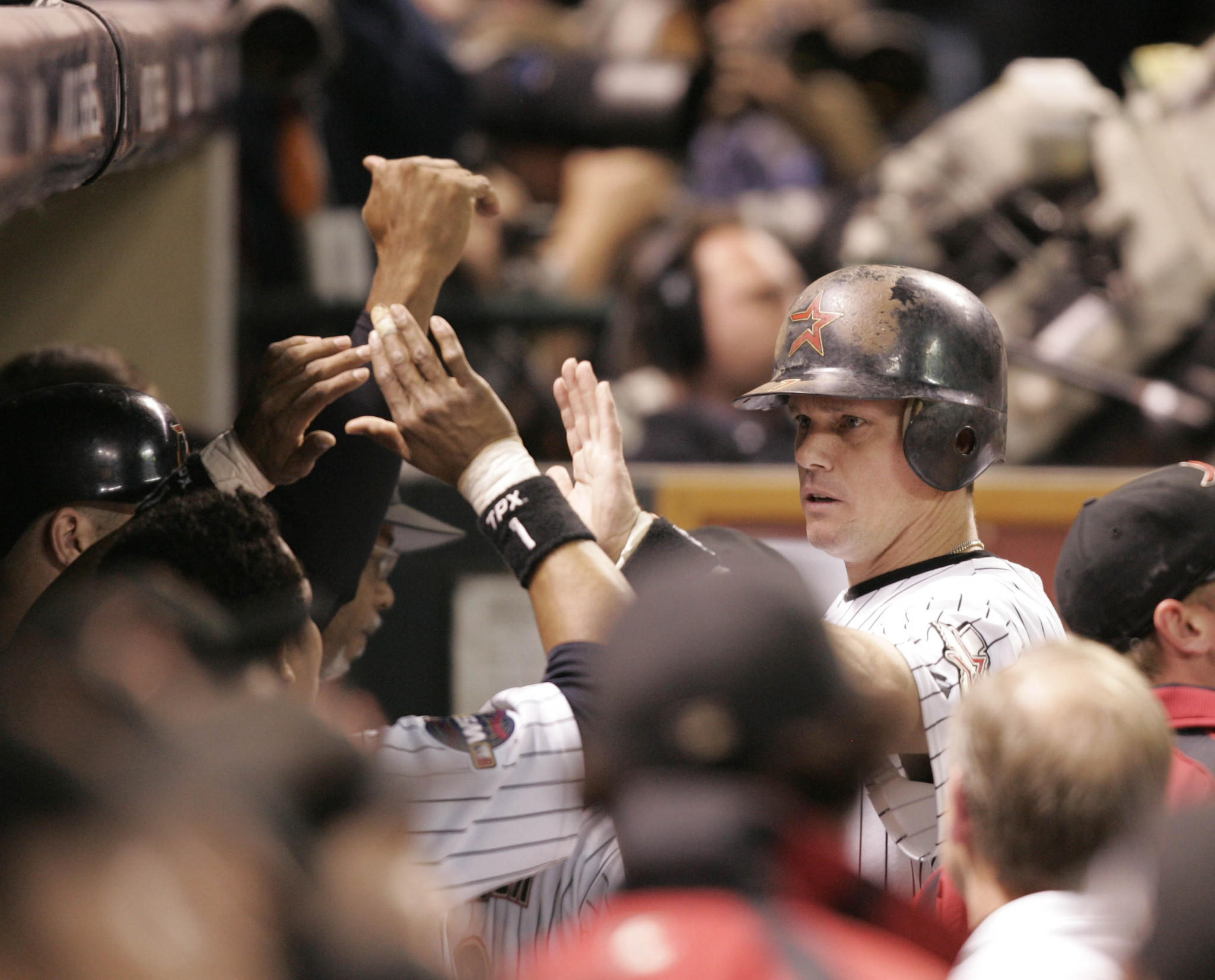 Craig Biggio is welcomed back to the dugout after he lead off with a double and scored the games first run on a Lance Berkman basehit during game 3 of the World Series at Minute Maid park in Houston TX Tuesday October 25, 2005.Tribune Photo by Scott Strazzante October 25, 2005 Chicago White Sox Houston Astros World Series Game 3 at Minute Maid Park in Houston, Texas.