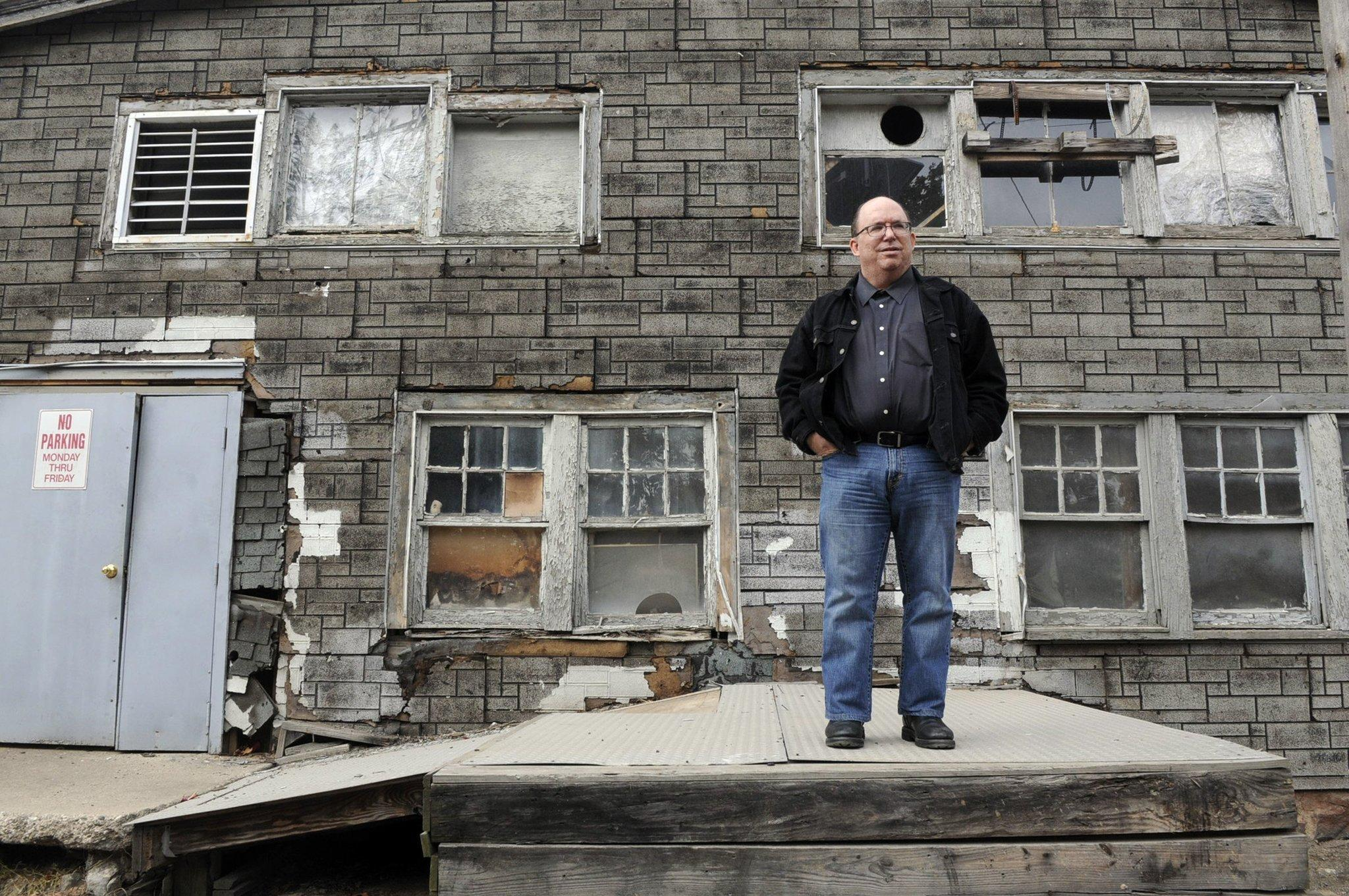 Tom Meyers, of the Fort Lee Film Commission, stands outside the dilapidated Englewood Cliffs, N.J., birthplace of Universal Studios.