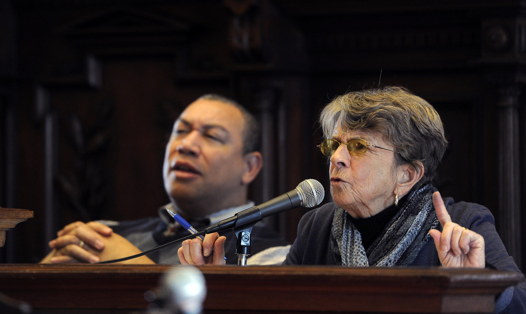 Council member Mary Pat Clarke, on right, asks a question at the Baltimore city council's taxation, finance and economic development committee hearing on Council Bill 13-0298, which concerns an excise tax on passenger-for-hire services, a temporary retroactive repeal of a law which taxes taxis. She is one of the bill's sponsors. Council member William Henry is on left.