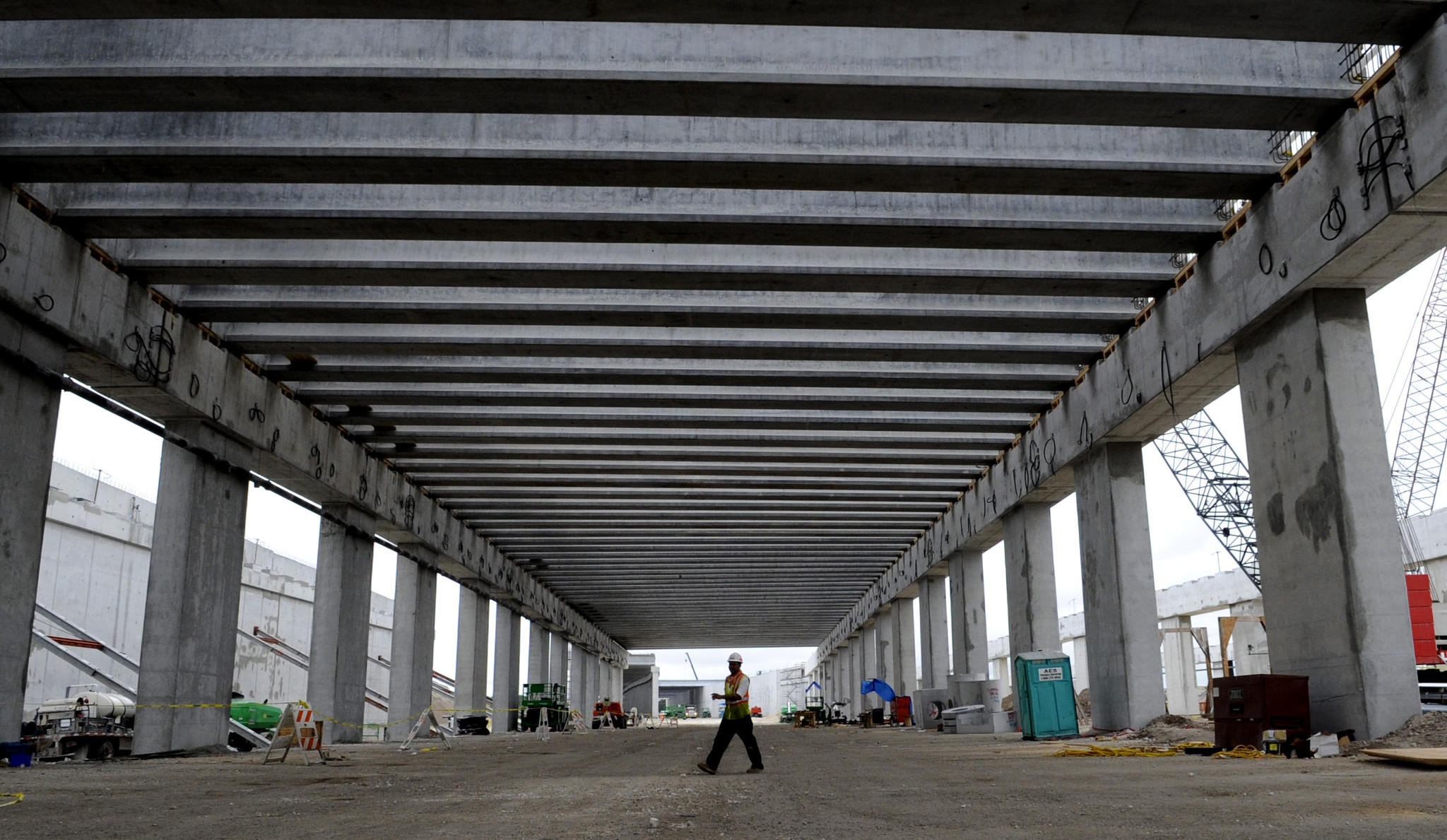 A construction worker walks under one of the 12 tunnels under the south runway at Fort Lauderdale/Hollywood Airport.