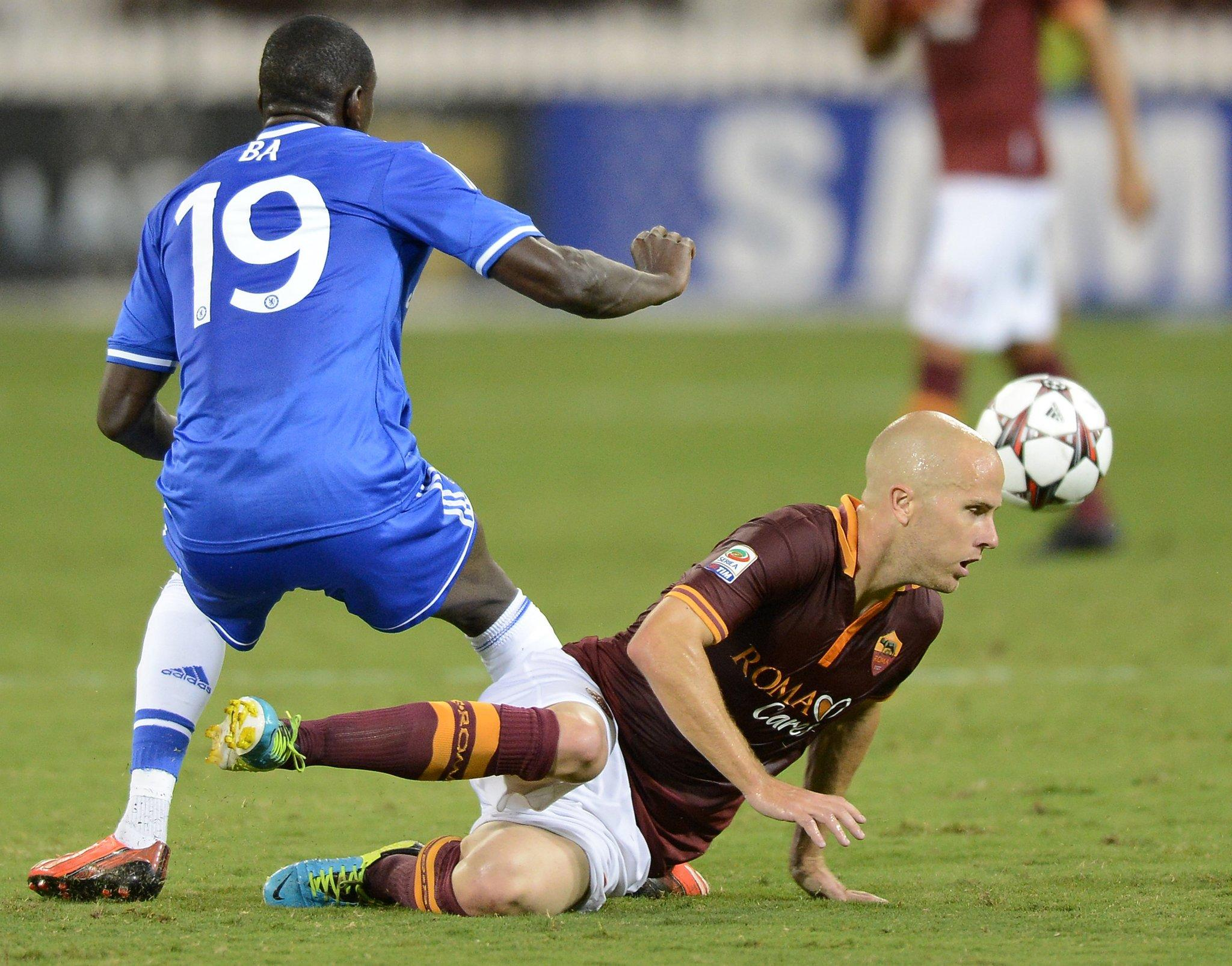 AS Roma midfielder Michael Bradley, right, attempts a tackle against Chelsea FC forward Demba Ba (19) in the second half of an internationals friendly at RFK Stadium in Washington.