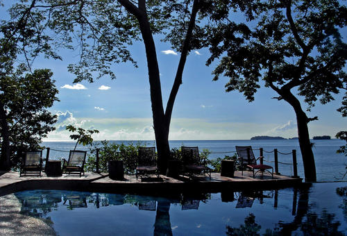 An infinity pool at the Cala Mia eco-resort appears to flow directly into the Pacific Ocean in Panama.